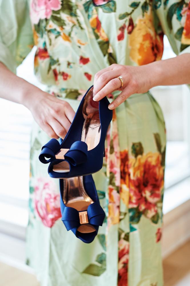 pair of blue satin wedding shoes