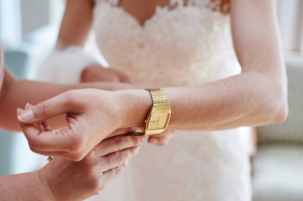 bride putting on father's watch