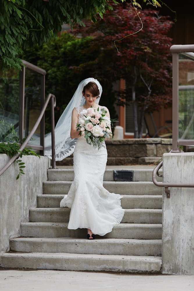 bride walking down steps of the cove west kelowna