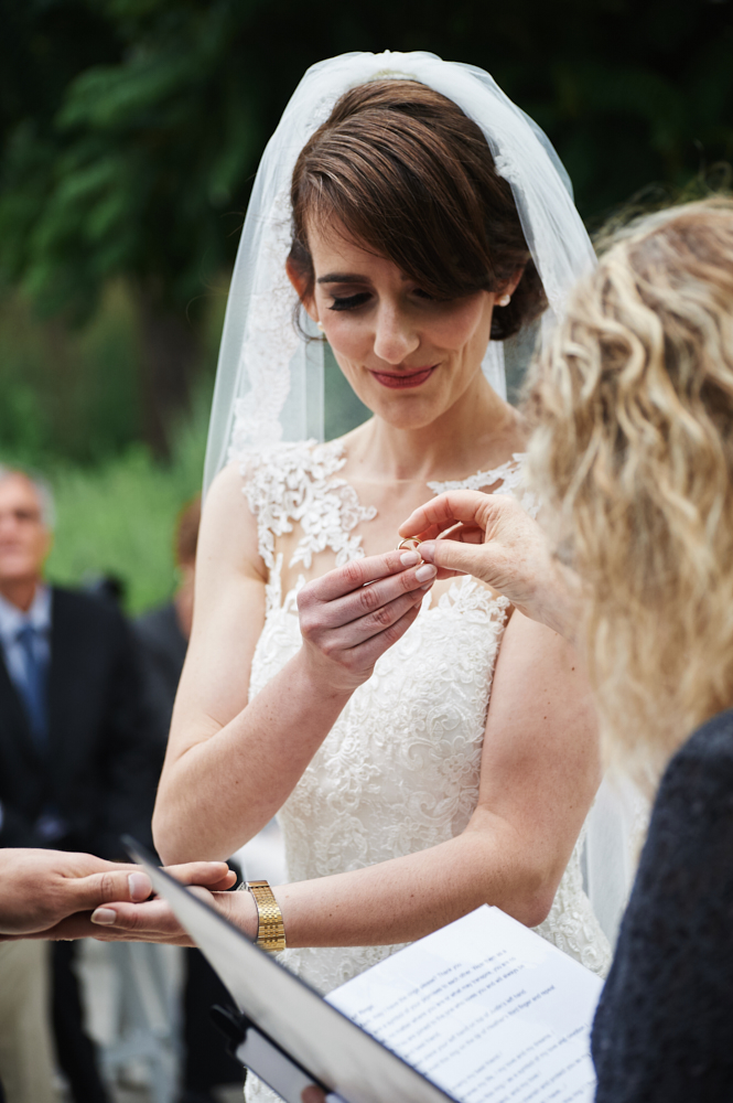 bride taking wedding rings