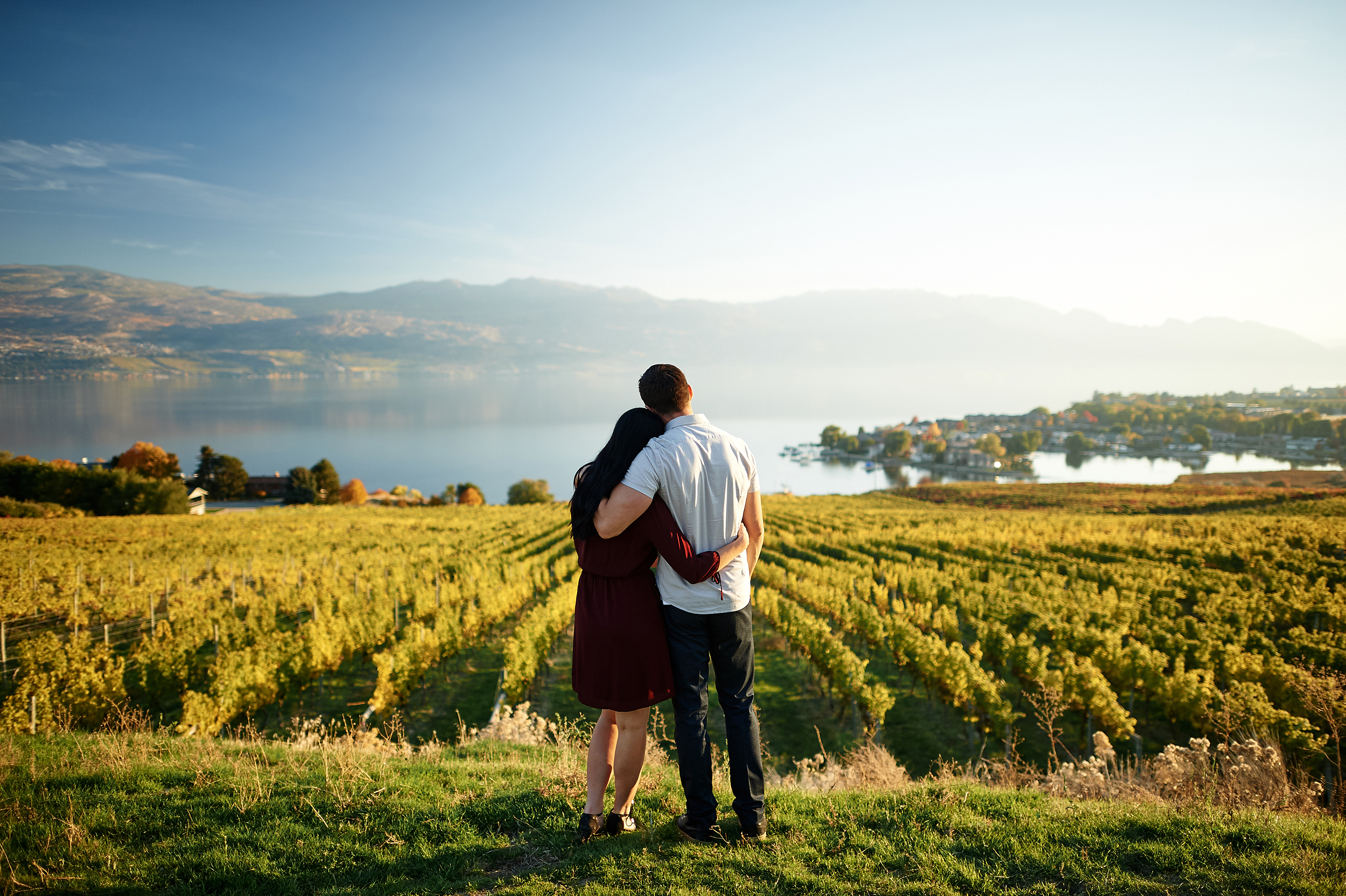 engaged couple by vineyard skyline