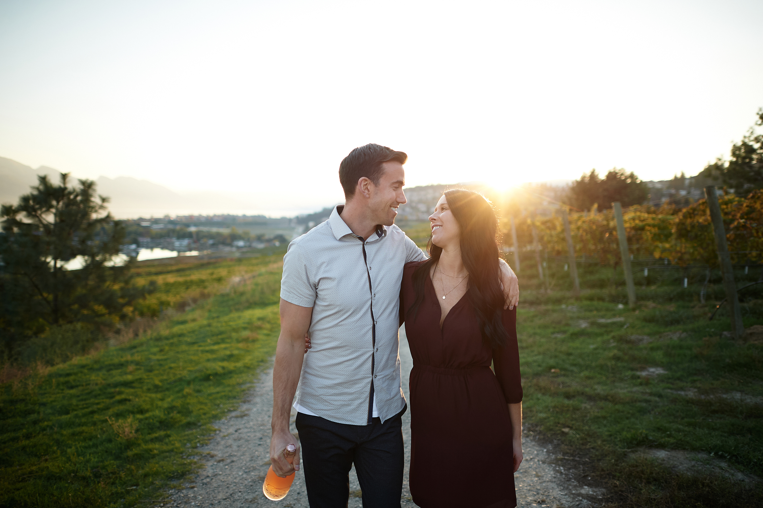 engaged couple walking in vineyard