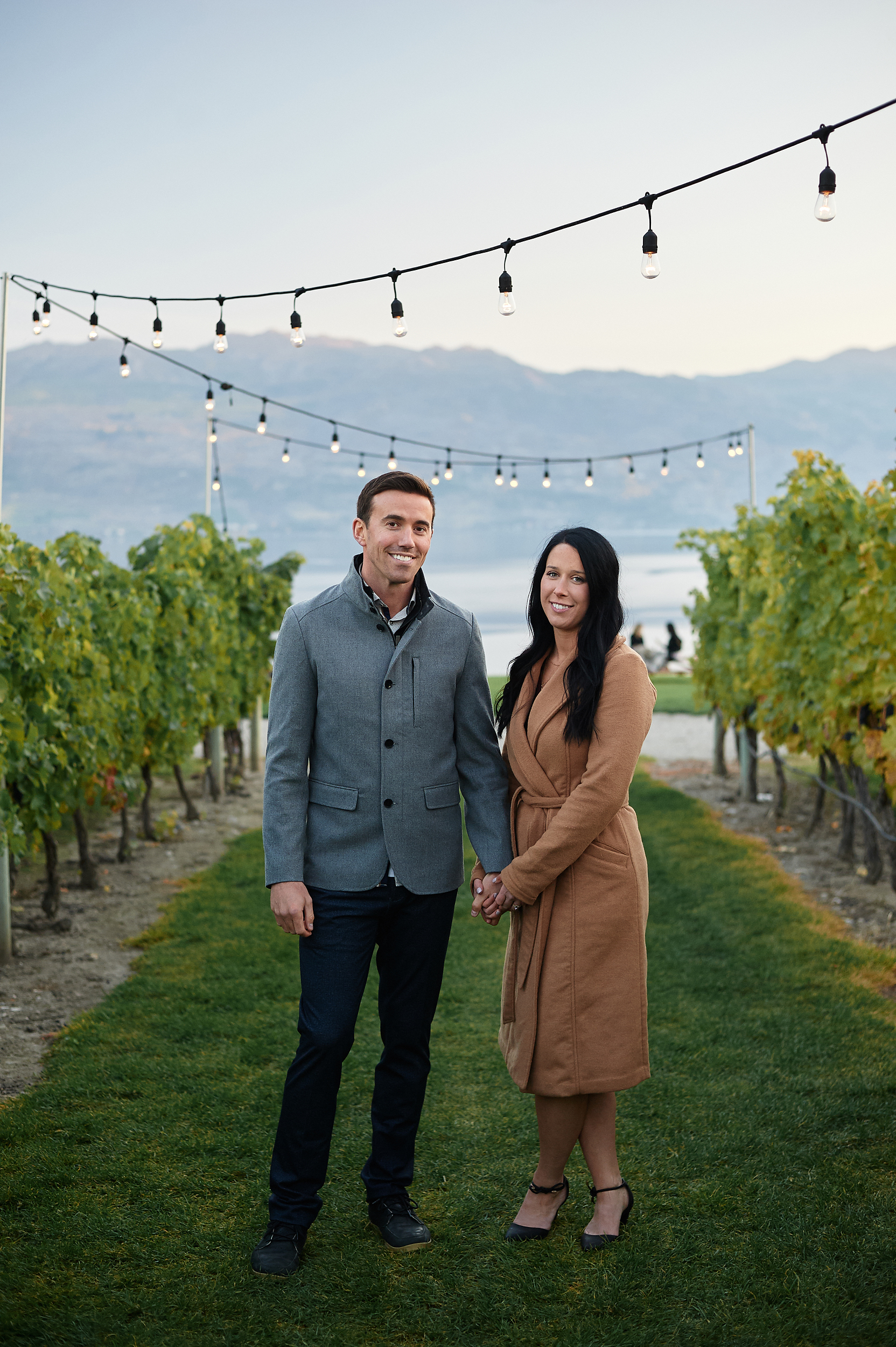 formal photo of engaged couple in vineyard