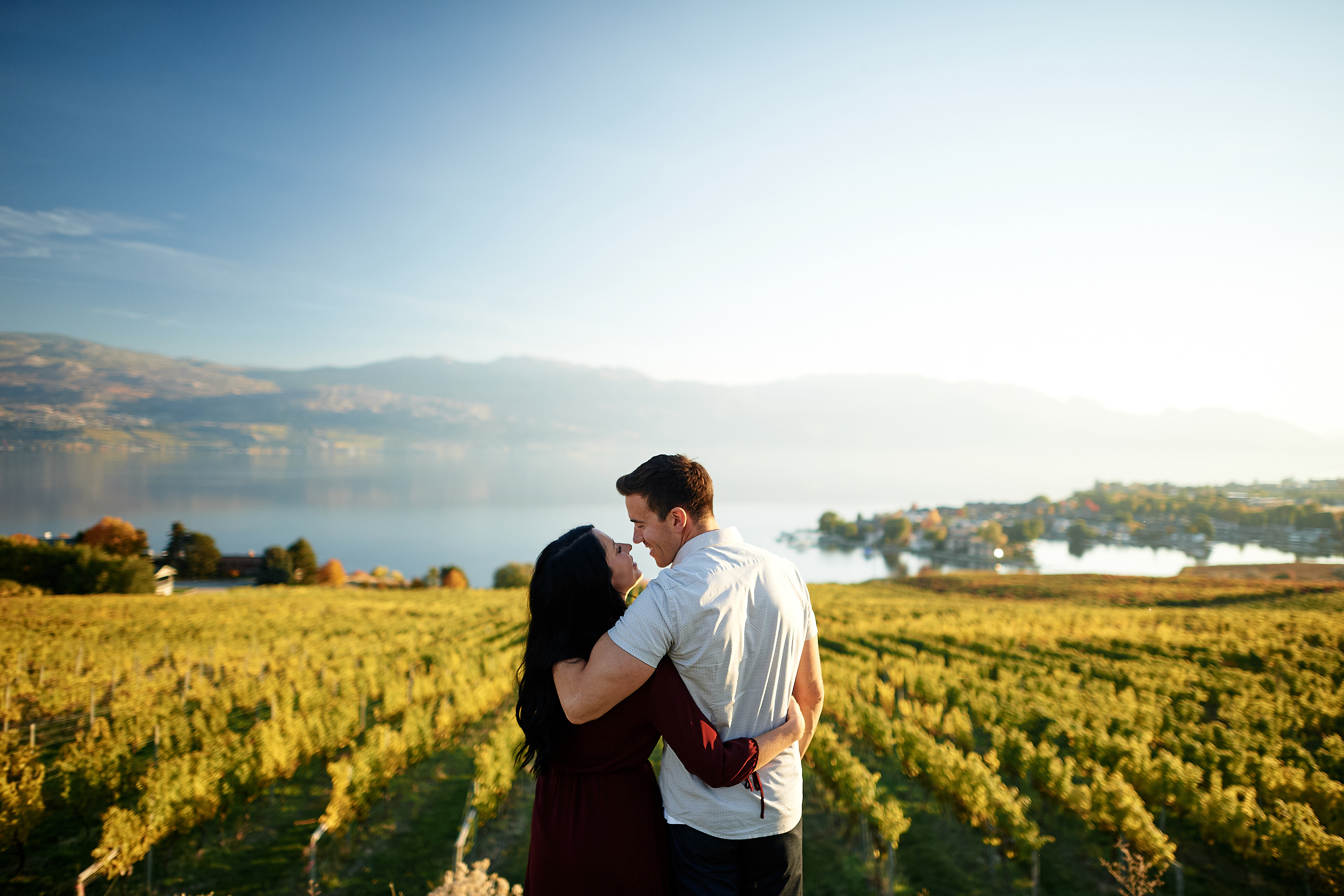 engaged couple by okanagan lake