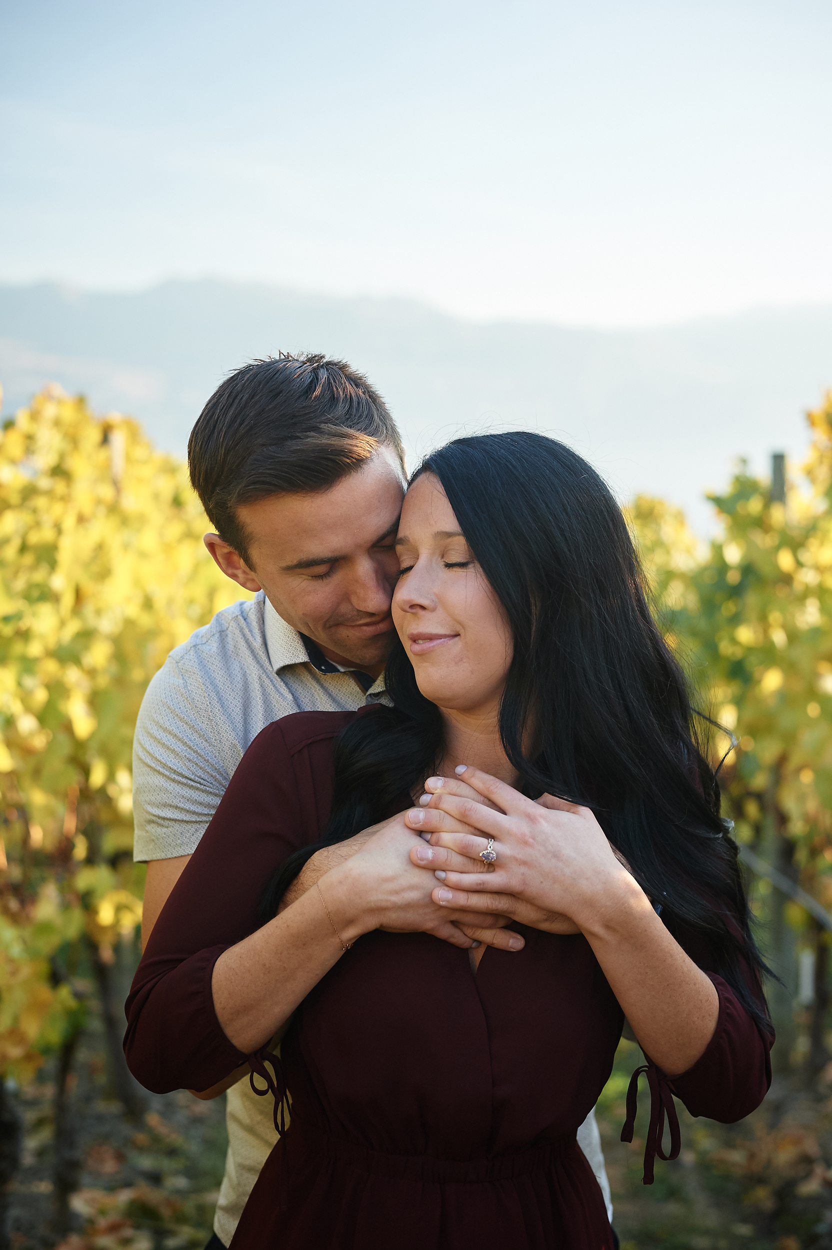 engaged couple in vineyard