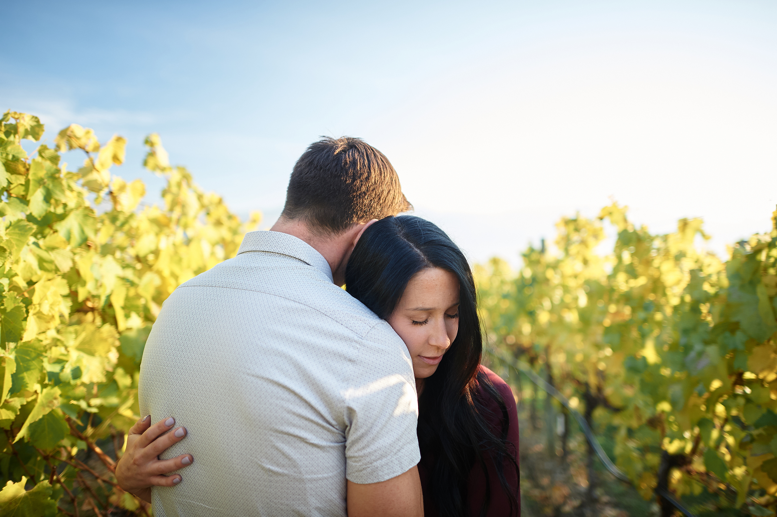 engaged couple in okanagan sunshine