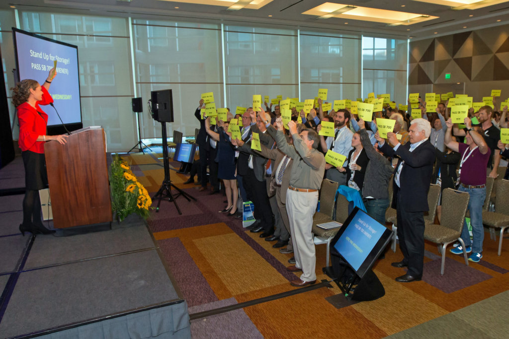 """Bernadette Del Chiaro, executive director of CALSEIA, led a social media campaign during Intersolar North America's opening ceremony last week as a final push before the legislative committee decided to let the energy storage bill die. Attendees held up pieces of paper saying, """"Pass SB 700."""""""