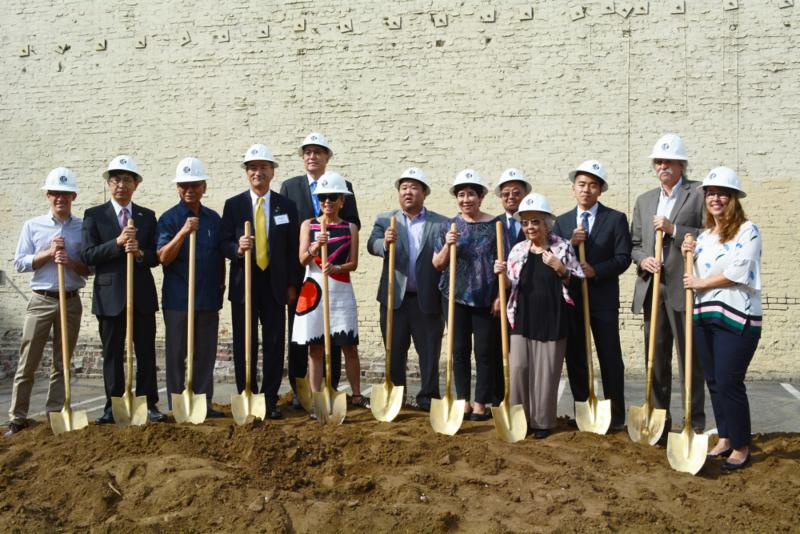 Key representatives, including Mitsubishi Electric US Inc. president and CEO Kent Hora (fourth from left), celebrate at the ground breaking ceremony for the new Budokan in Little Tokyo on August 3.