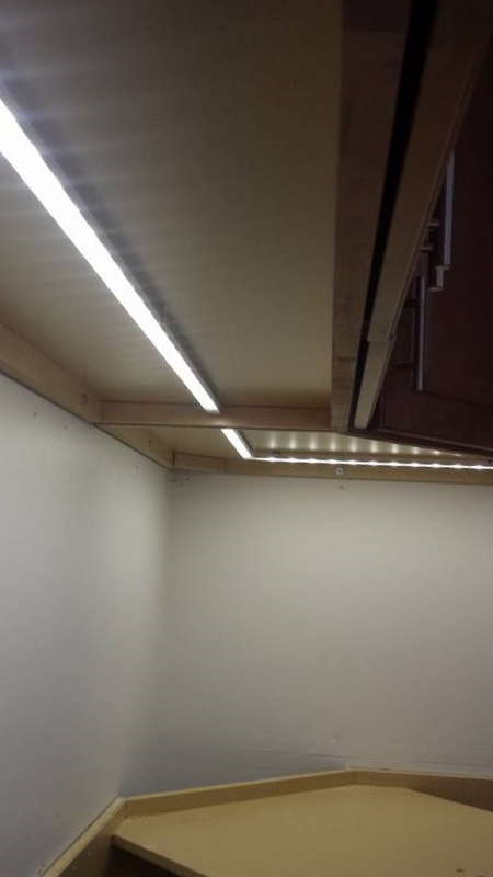 Custom LEDunder-cabinet lighting in aluminum track with clear shield.