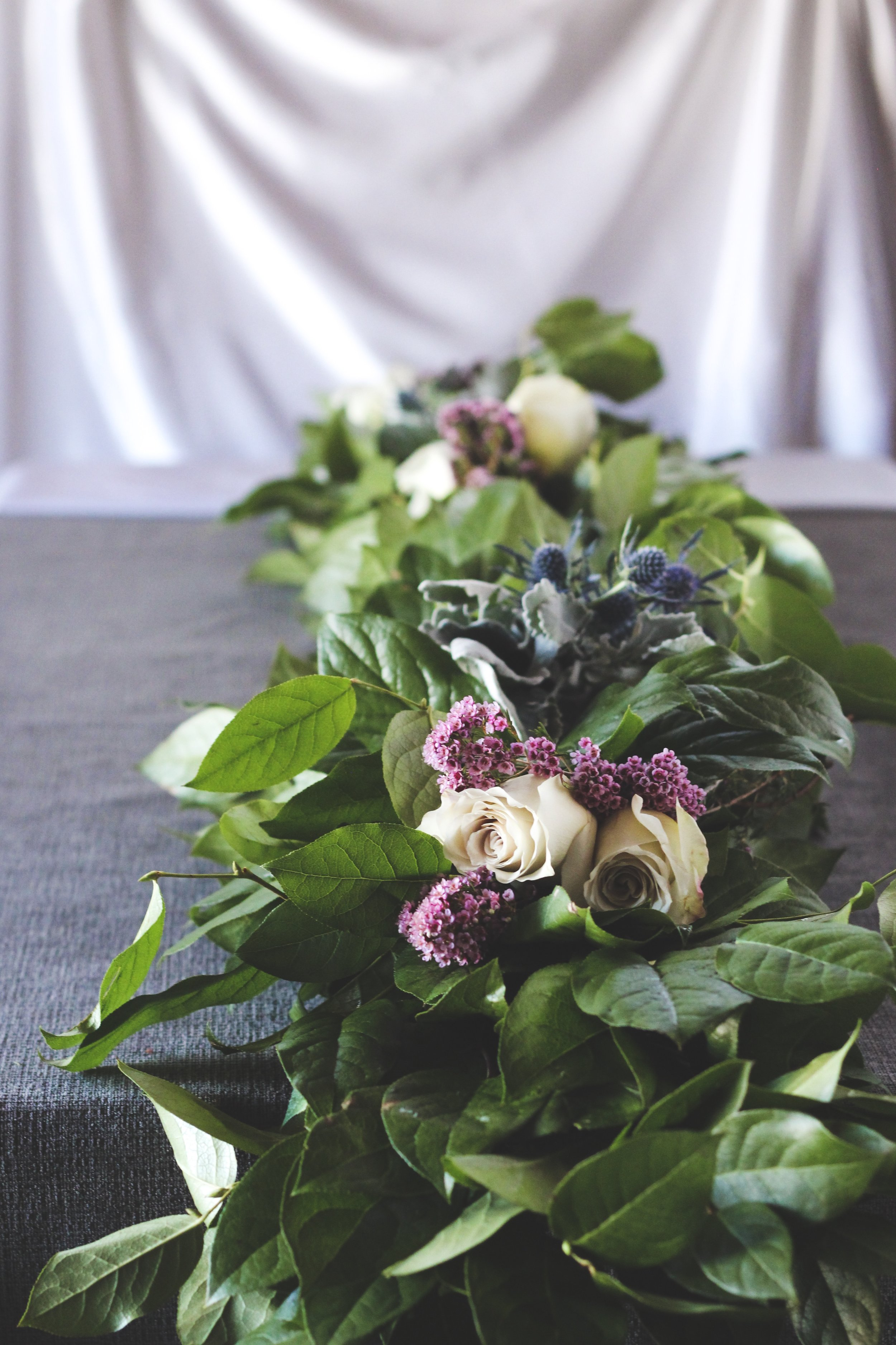 garland with roses and blue thistle-rootsandwildflowers