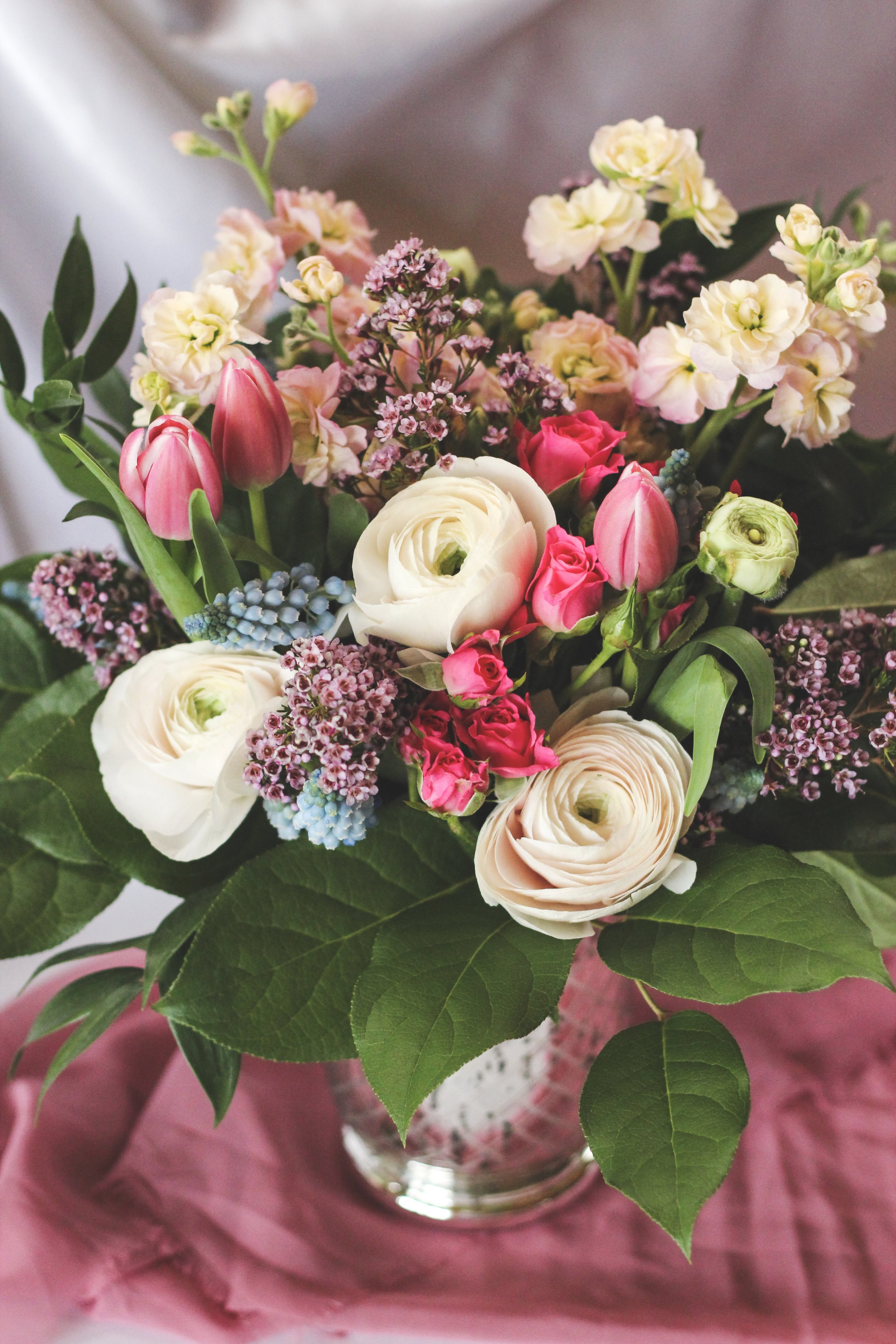 Mothers day white ranunculus pink tulip pink spray rose flower arrangement - Roots and Wildflowers