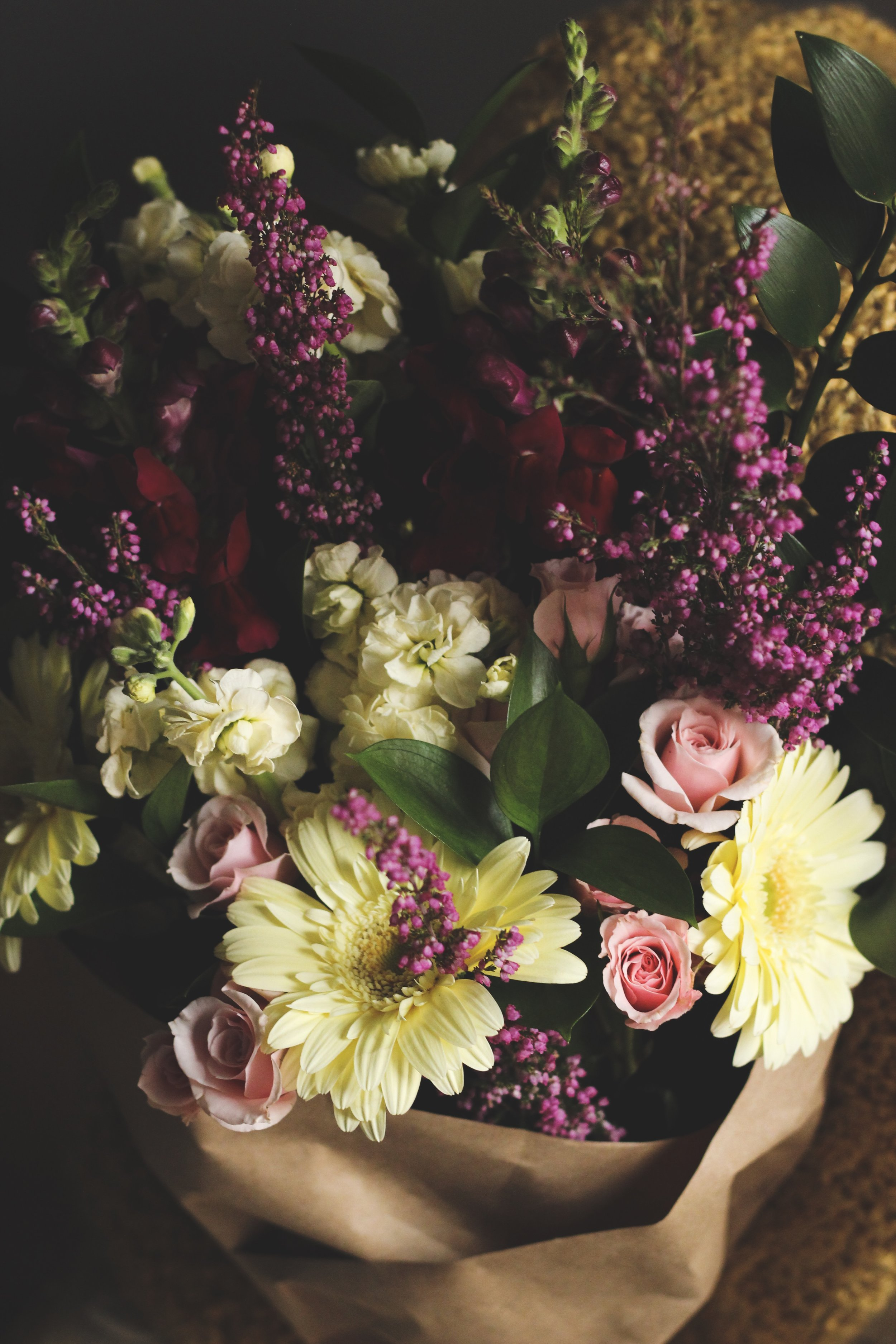 Romantic Valentines day arrangement with pastel daisies purple snapdragons and pink roses - Roots and Wildflowers