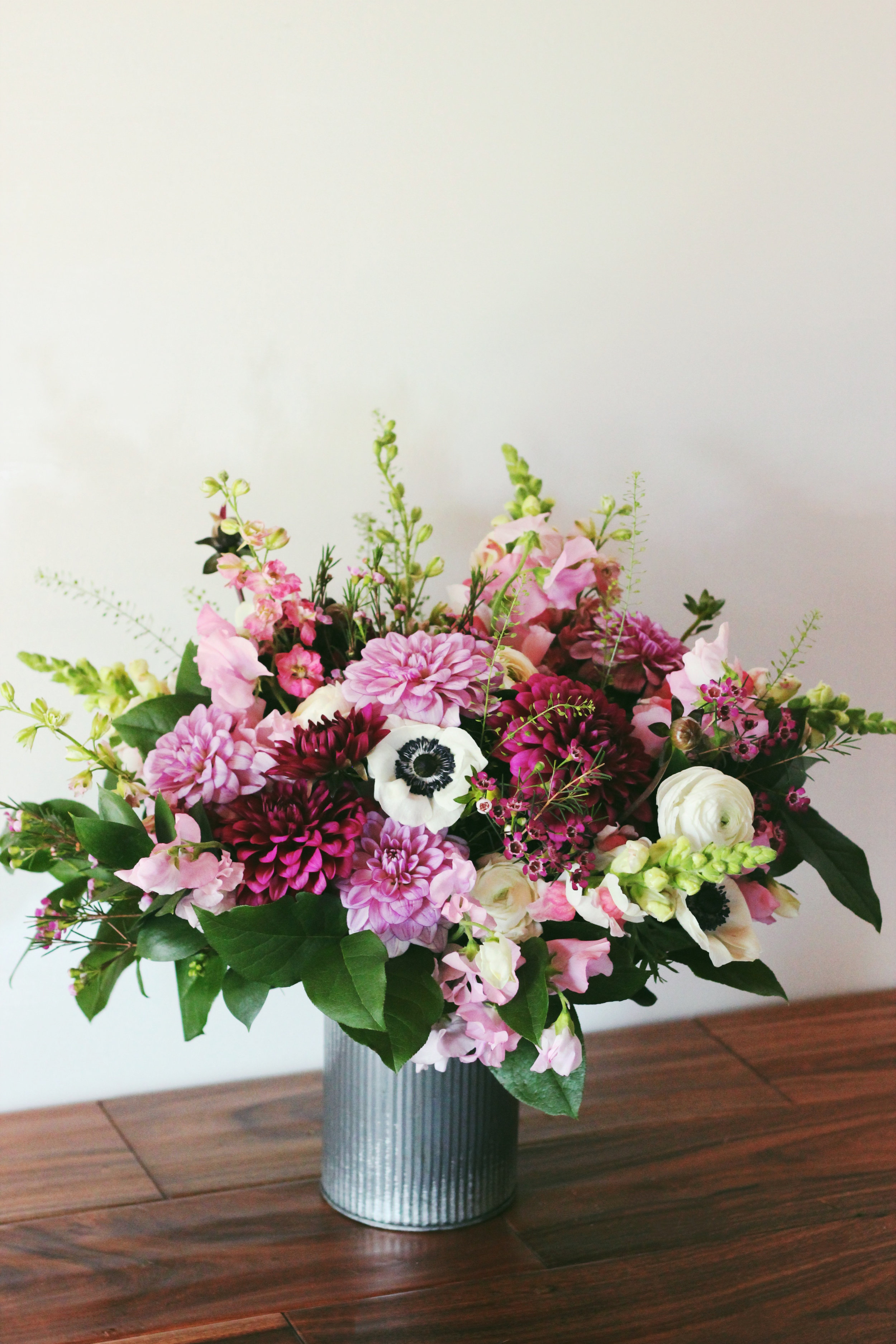 Pink and purple dahlia snapdragon white and black anemone white ranunculus farmers choice flower arrangement - Roots and Wildflowers