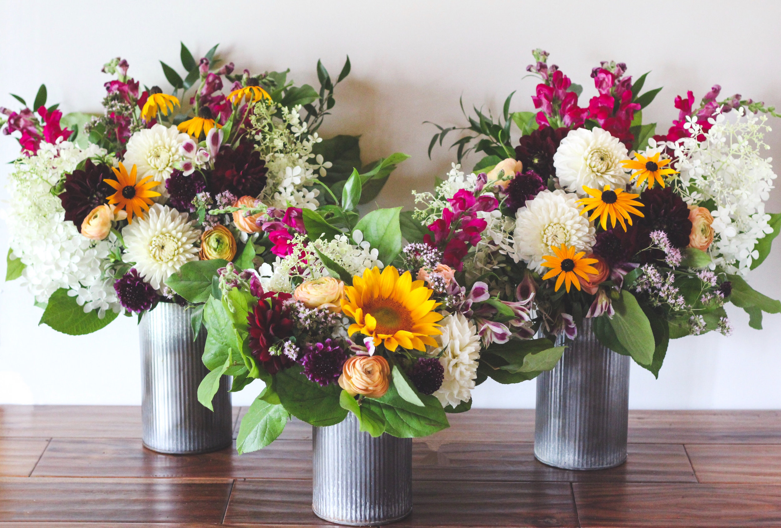 White hydrangea, purple and white dahlias, purple scabiosa, black eyed susan and snapdragons Farmers choice flower arrangement - Roots & Wildflowers