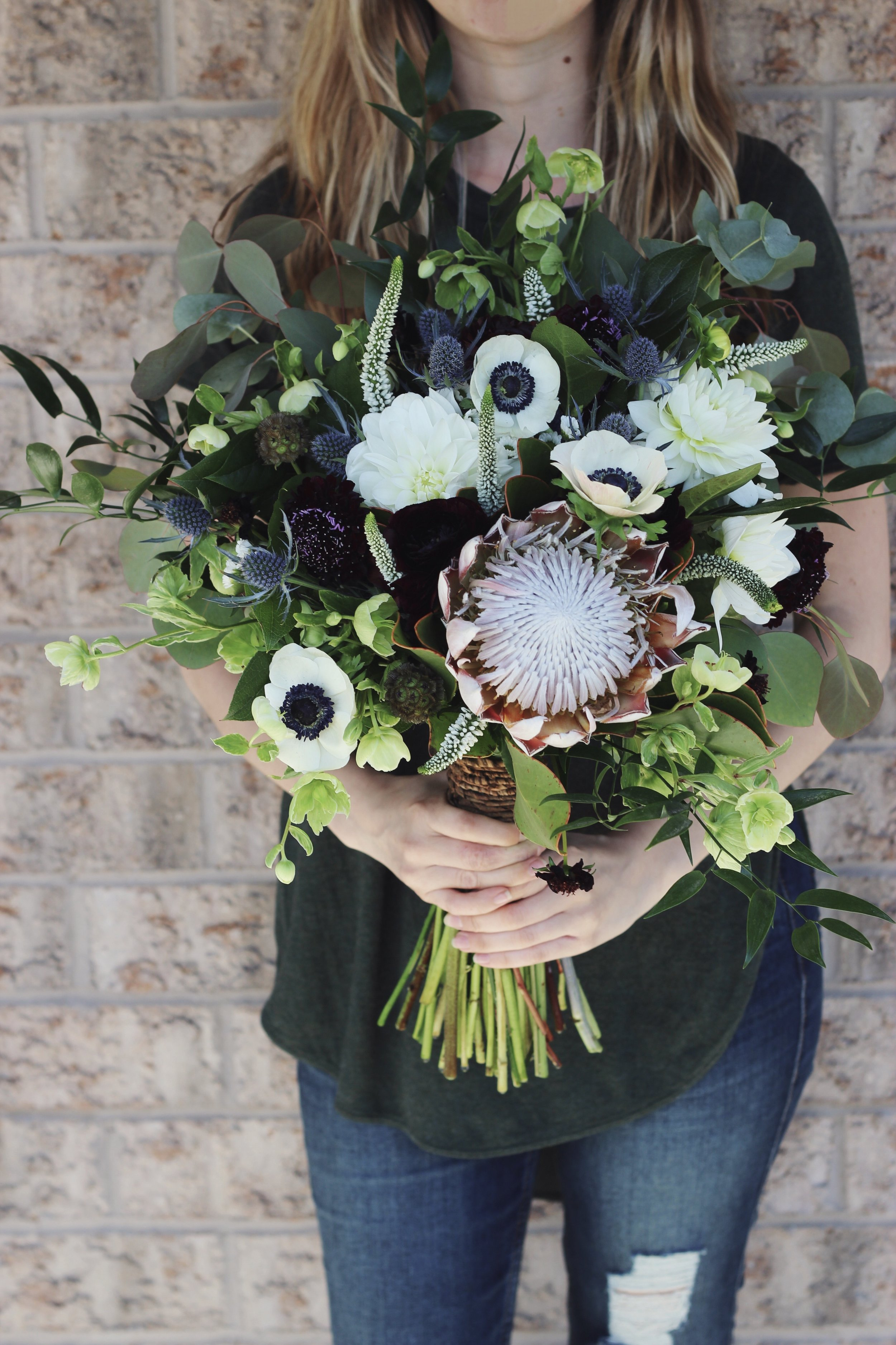 King protea white blue bridal bouquet with  anemone dahlias scabies and veronica with loose greenery June wedding at The Lake House in Pickering Ontario Canada - Roots and Wildflowers