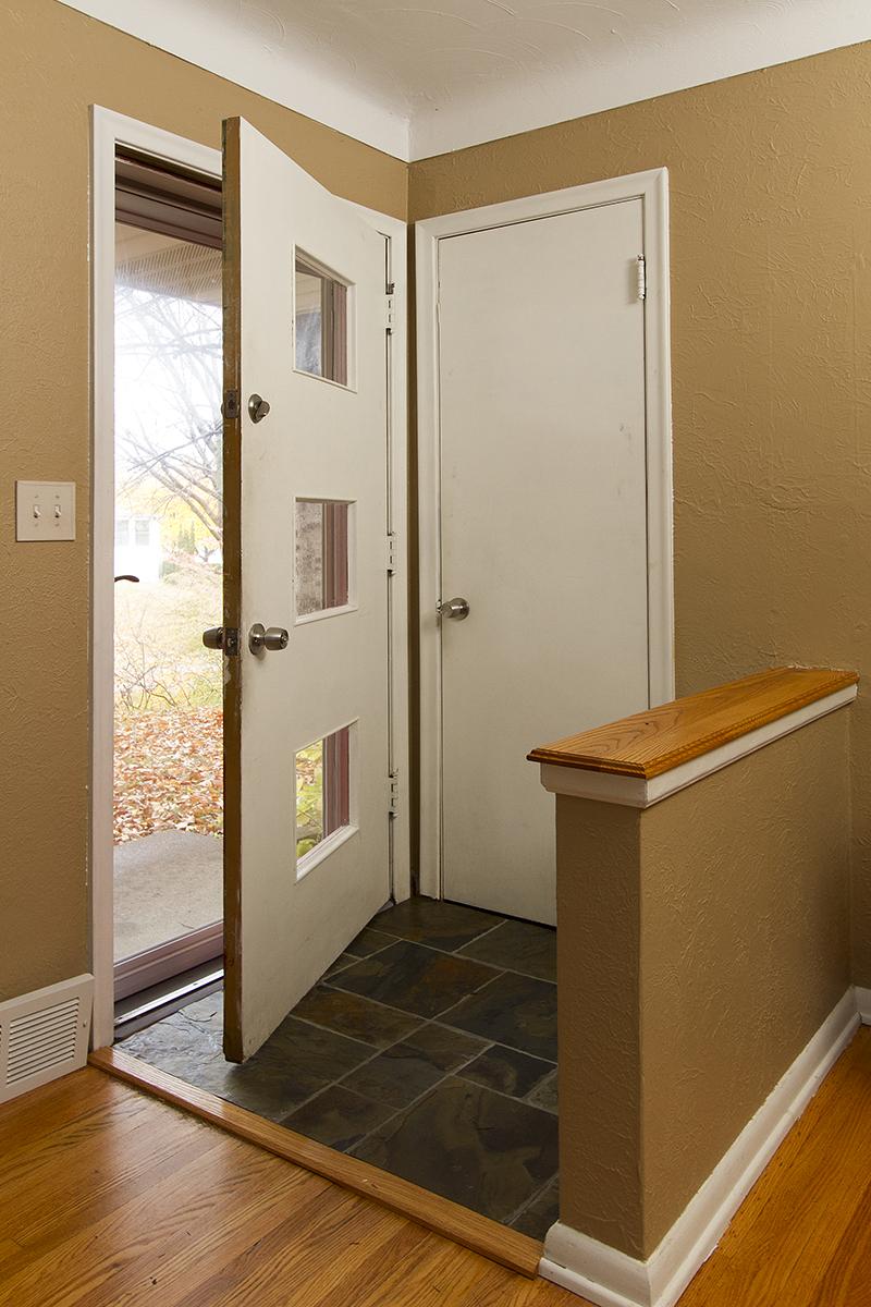 web_foyer door open vert.jpg