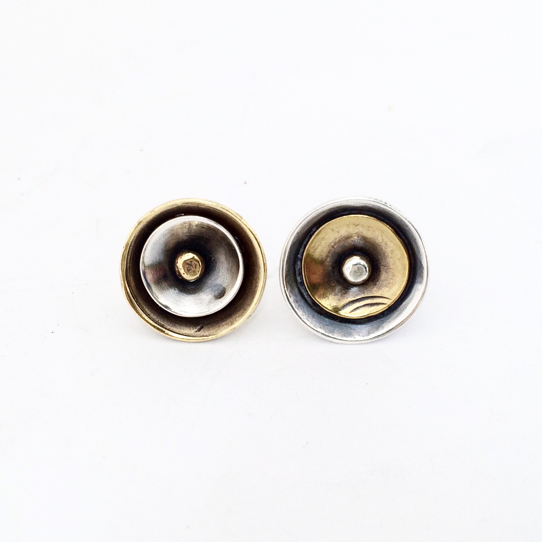 silver and brass post earrings