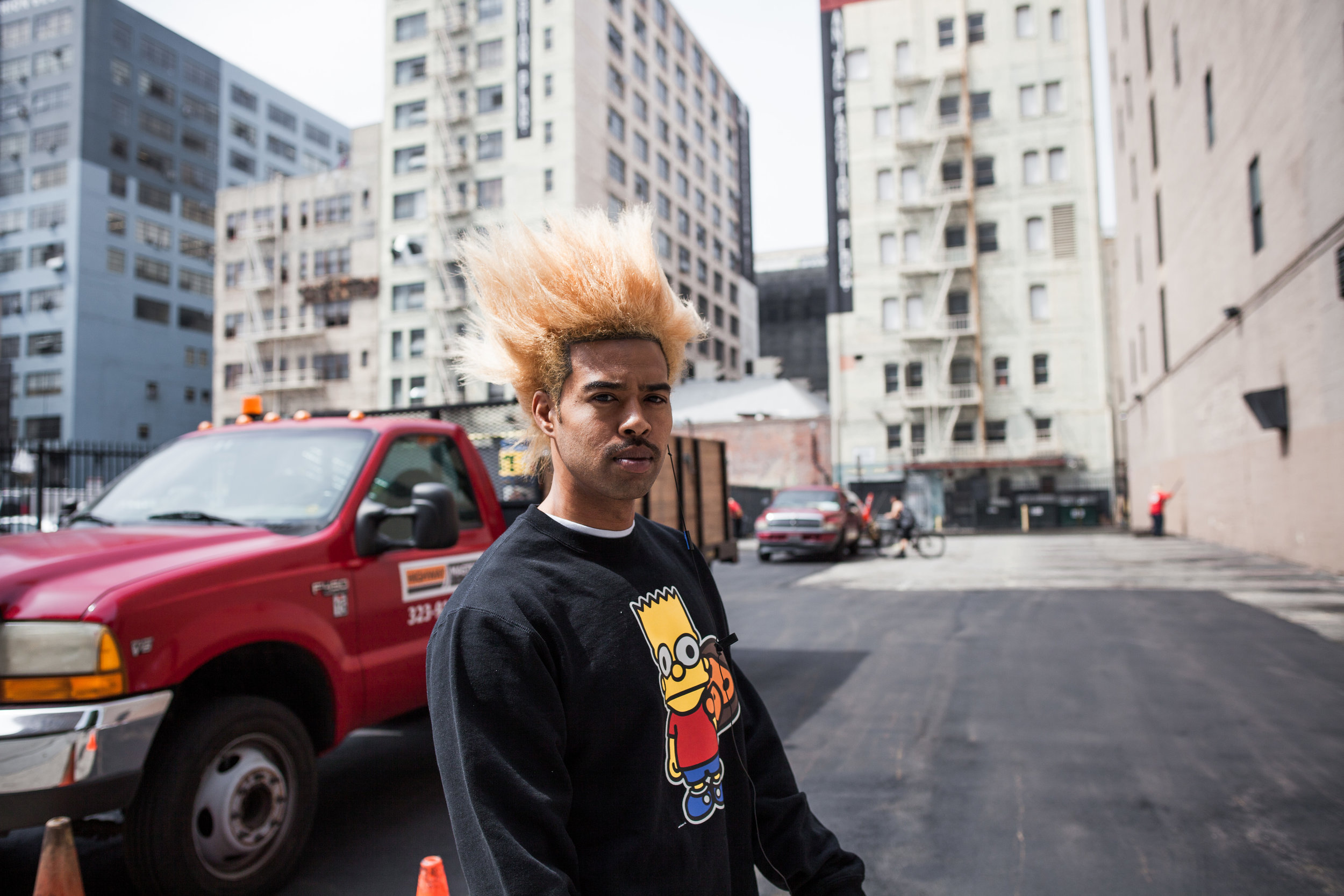 this is not nick but rather a photo he took in los angeles of a guy with bart simpson hair