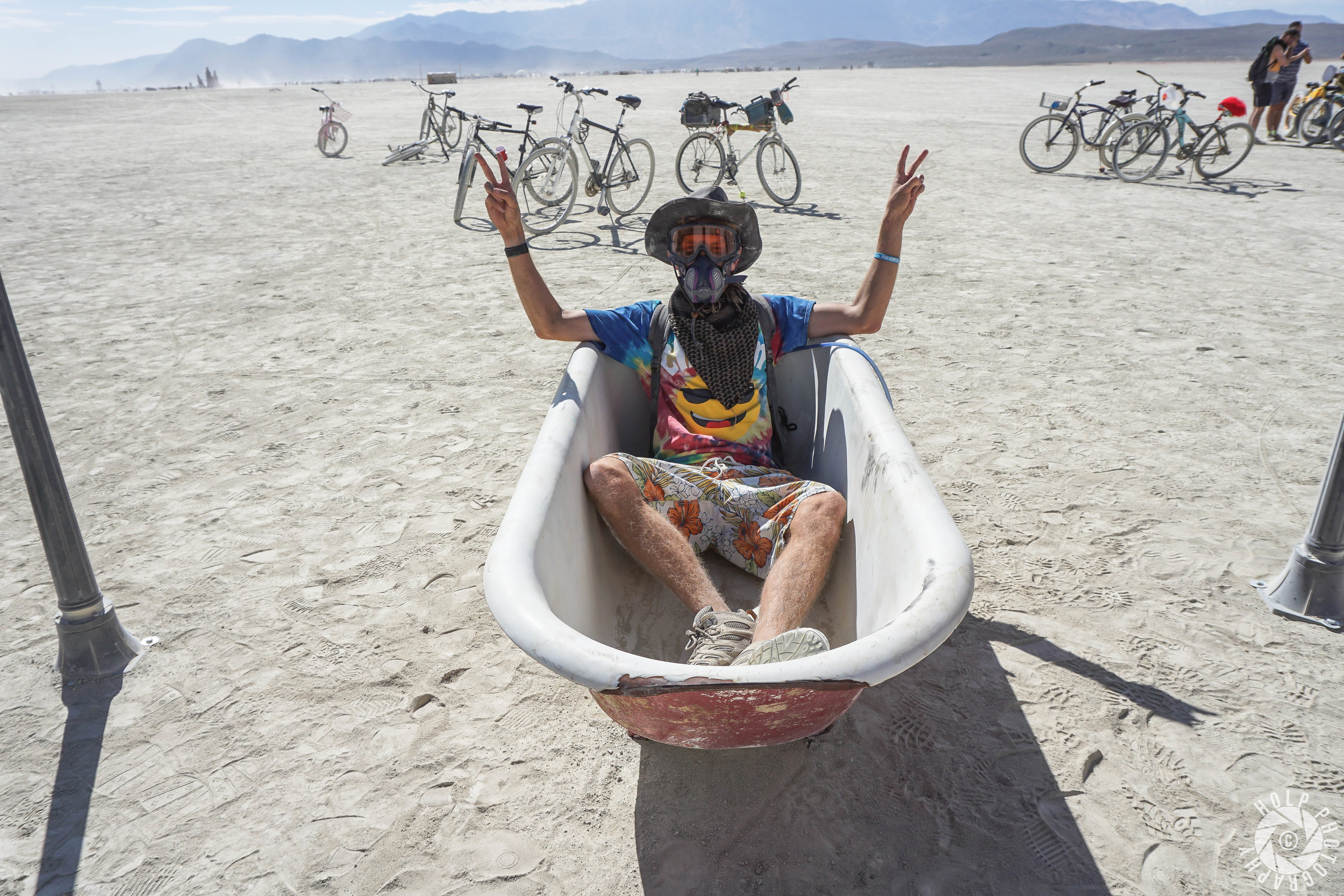 Chilling in a bathtub on the playa. Wearing my mask and goggles when it's not necessary.