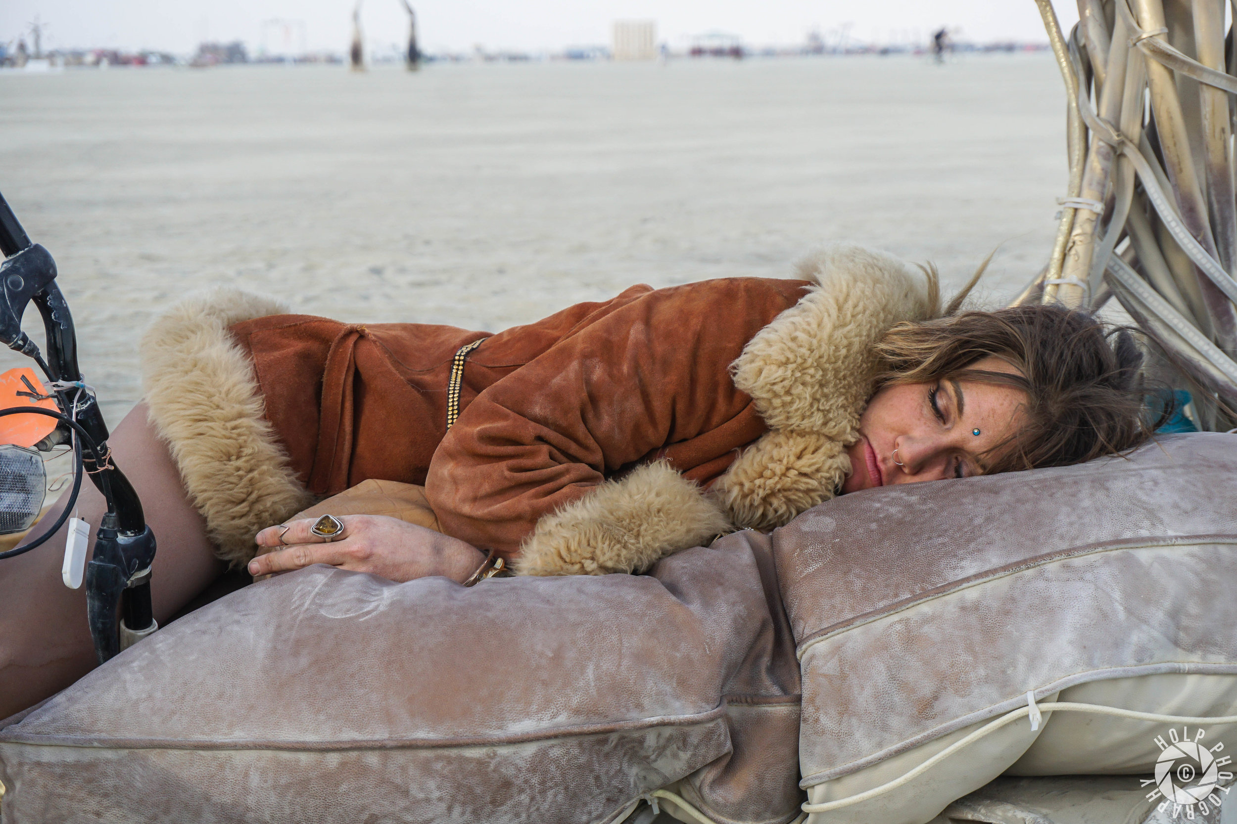 Beautiful candid photo of a woman sleeping after a long night of partying.