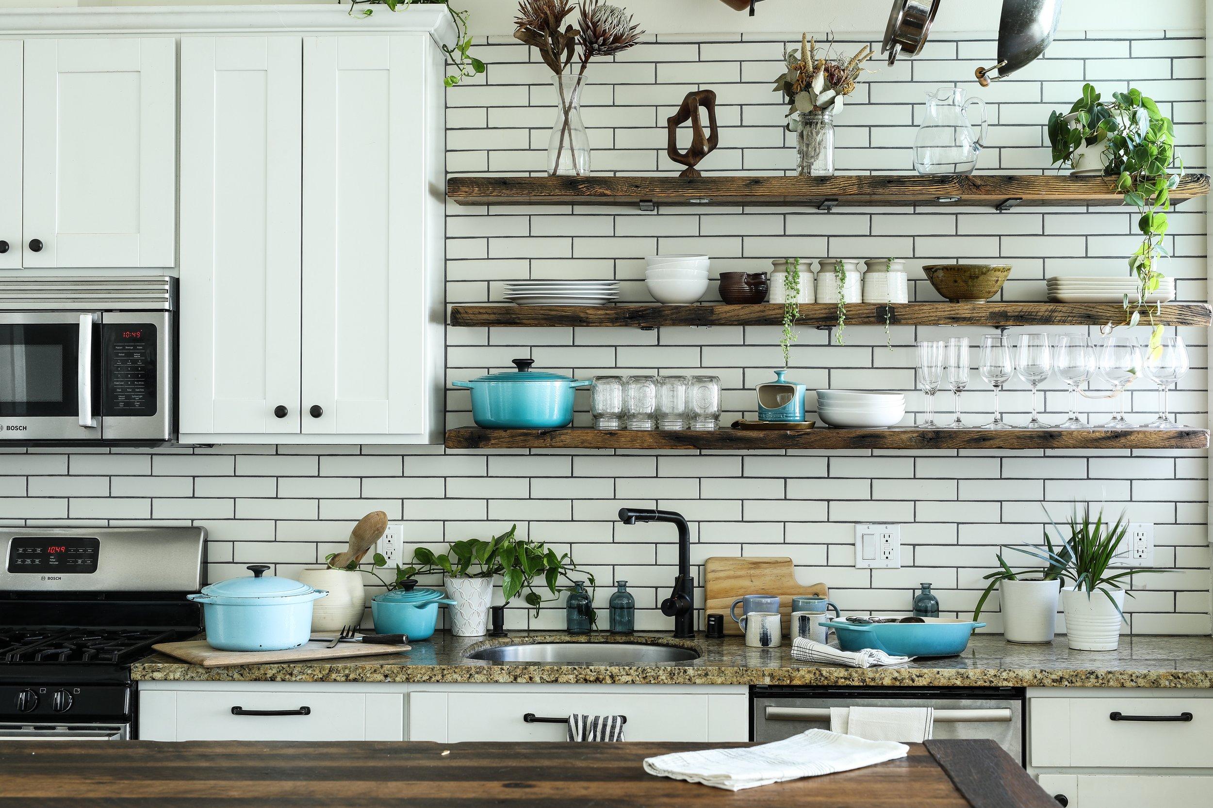 Organized kitchen with greenery.jpg