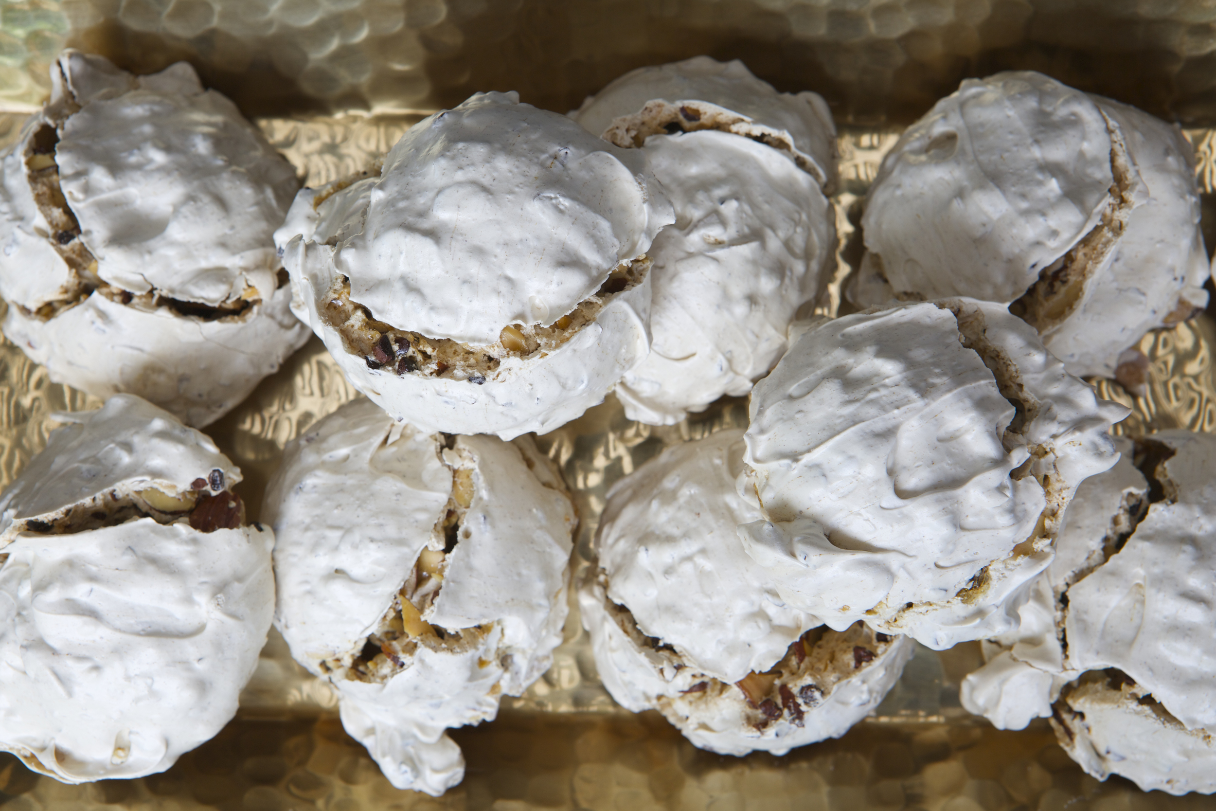Crispy meringue cookies with cocoa nibs and almonds.