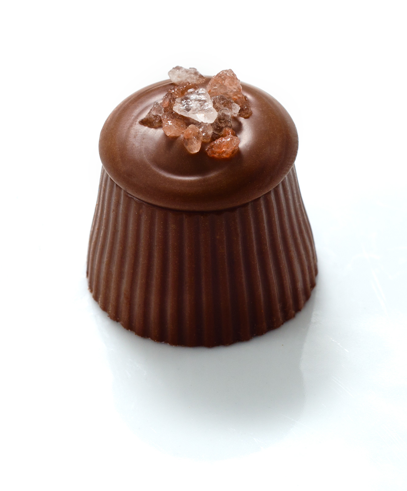 <b>SALTED PEANUT</b><P ALIGN=Left>Milk chocolate casing with peanut butter center finished with Himalayan pink salt</P>