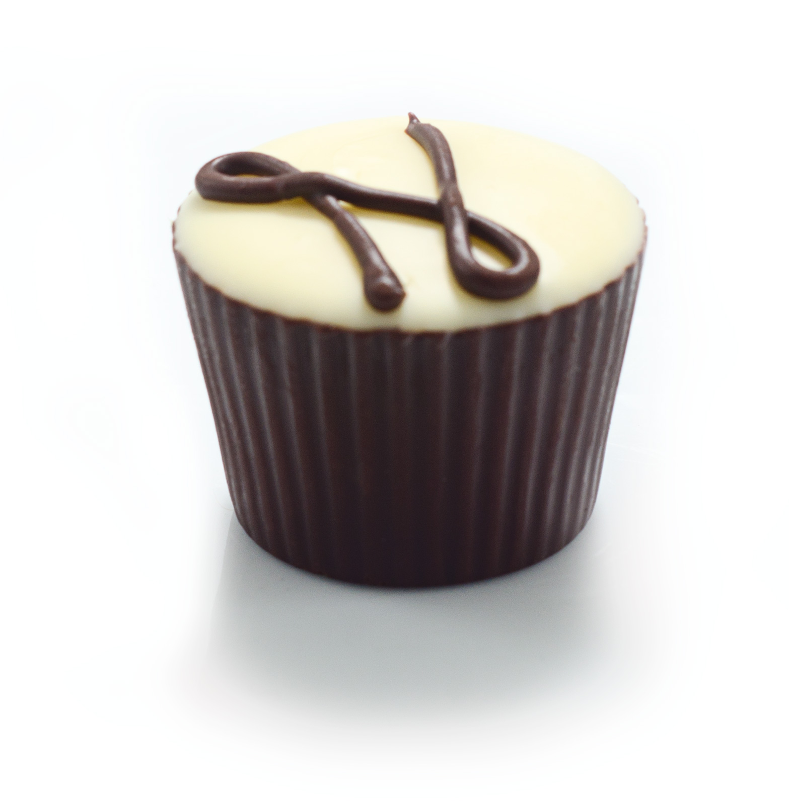 <b>LATTE</b><P ALIGN=Left>Dark chocolate casing with white chocolate center infused with fresh coffee</P>