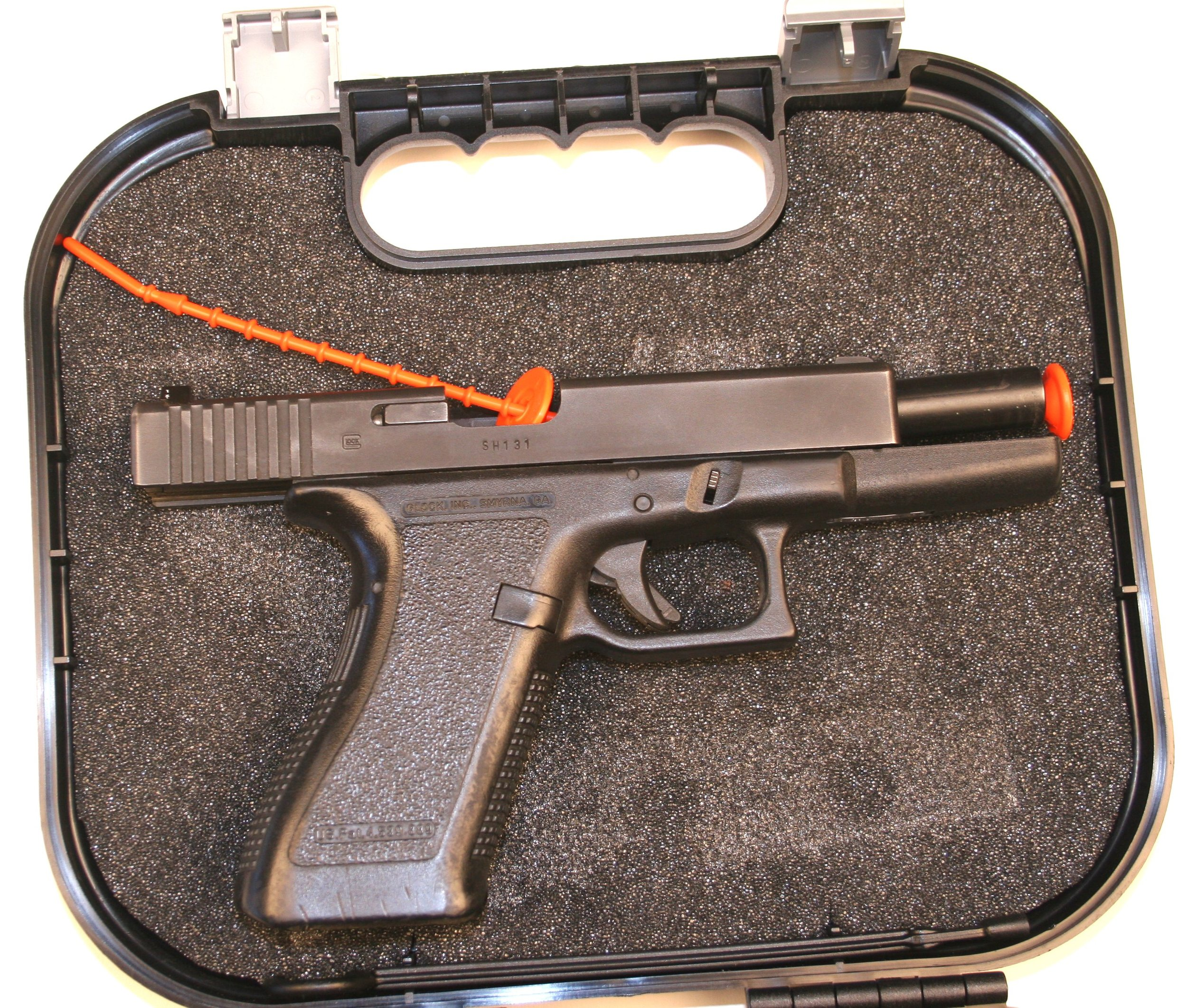 Glock in case locked back with indicator.jpg