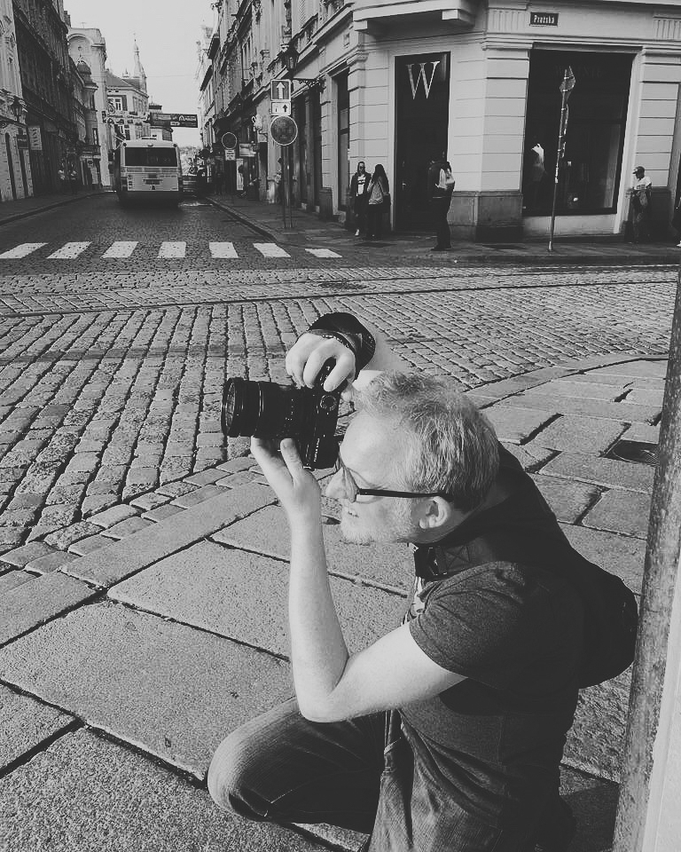 On Assignment   Capturing the evening sunshine in Plzen, Check Republic. One camera around the wrist the other as a back up in the sling bag. I'm on assignment for Pilsner Urquell brewery, snapping the place where it all started.