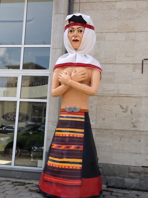 Art on the streets is also three dimensional. This topless lady awkwardly stands outside the bus station in Gabrovo.