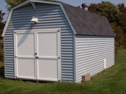 "New ""Azek"" doors were added to this store shed as well as new vinyl siding and a new roof"