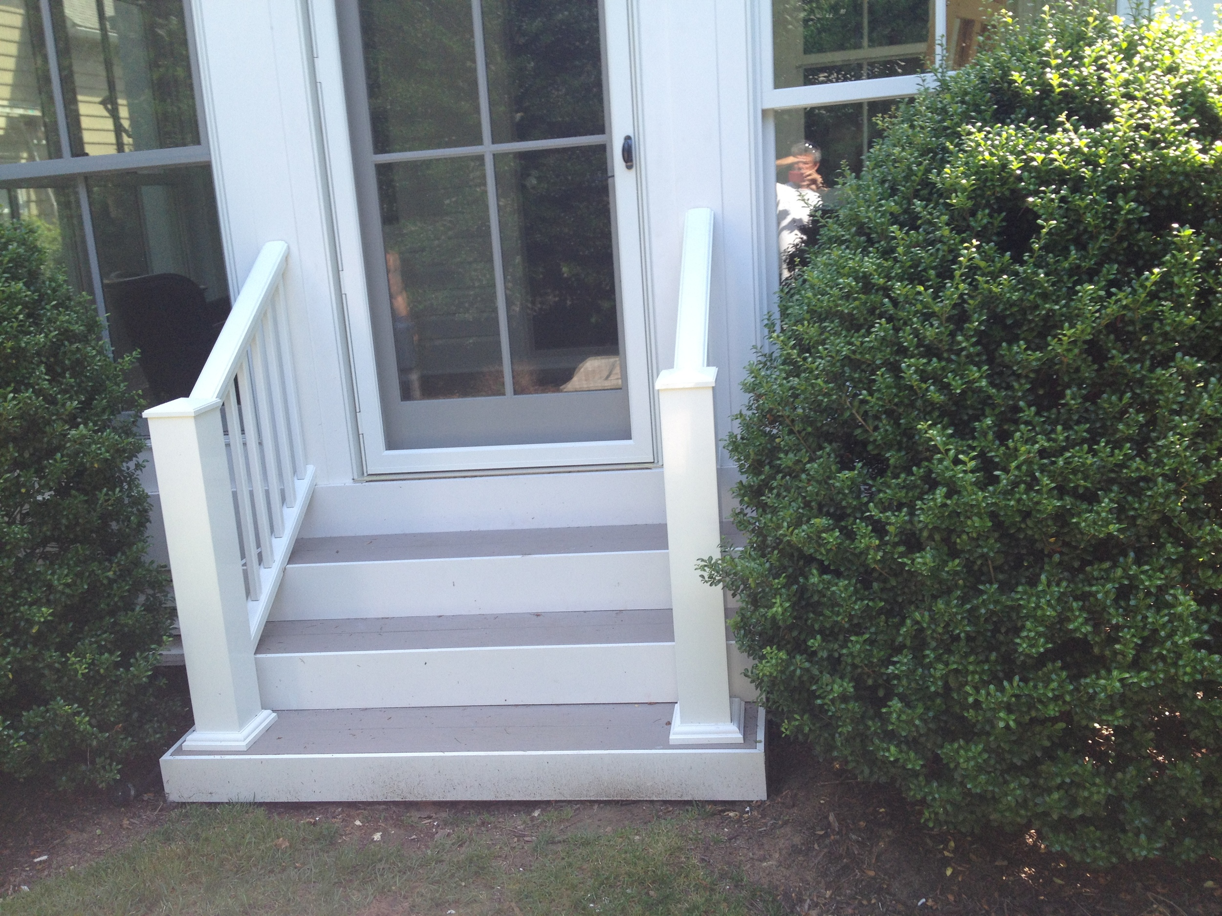 A porch was enclosed using Marvin windows and an over sized door.