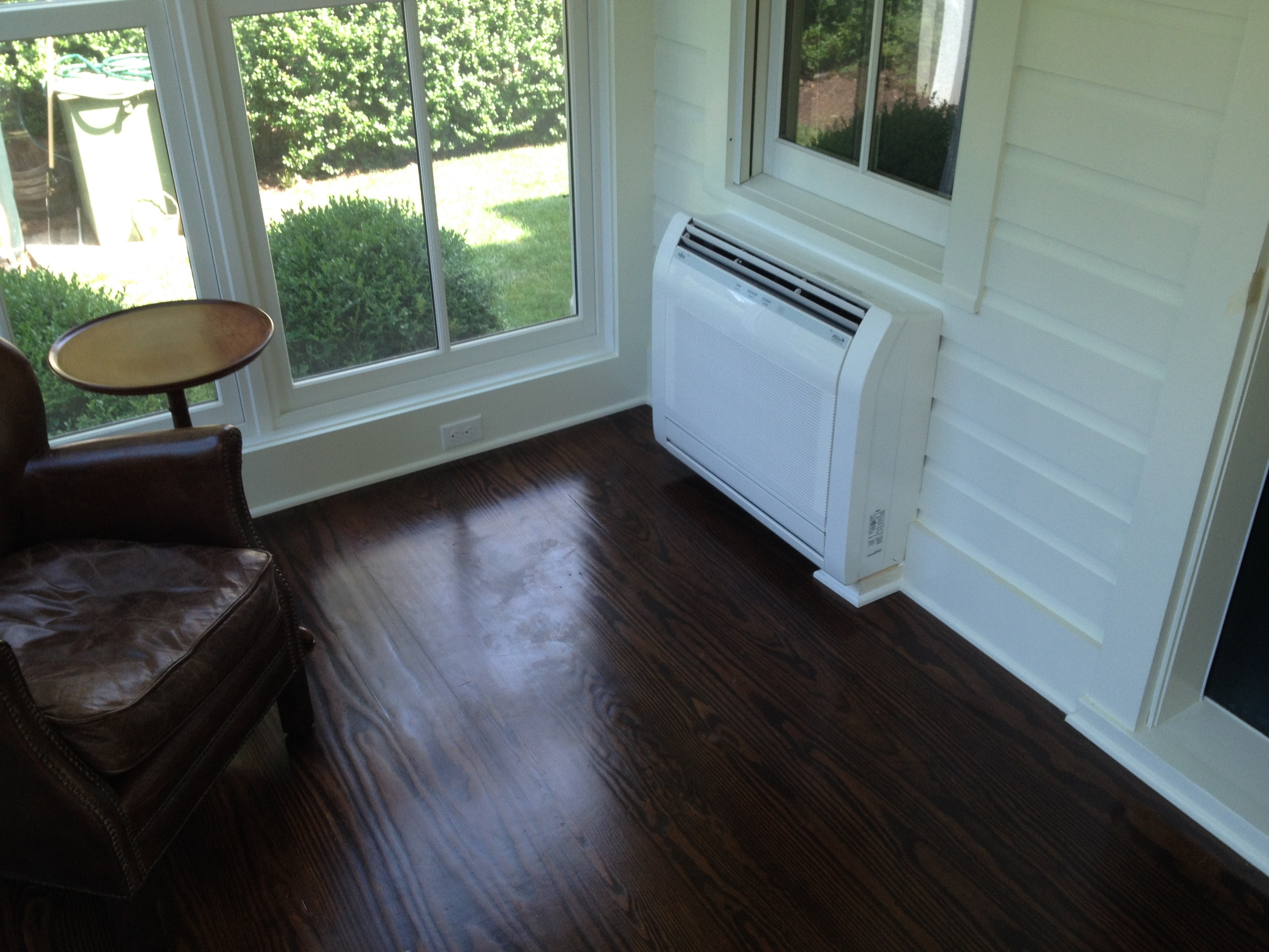 A porch was enclosed using Marvin windows and an over sized door. A new HVAC system was included