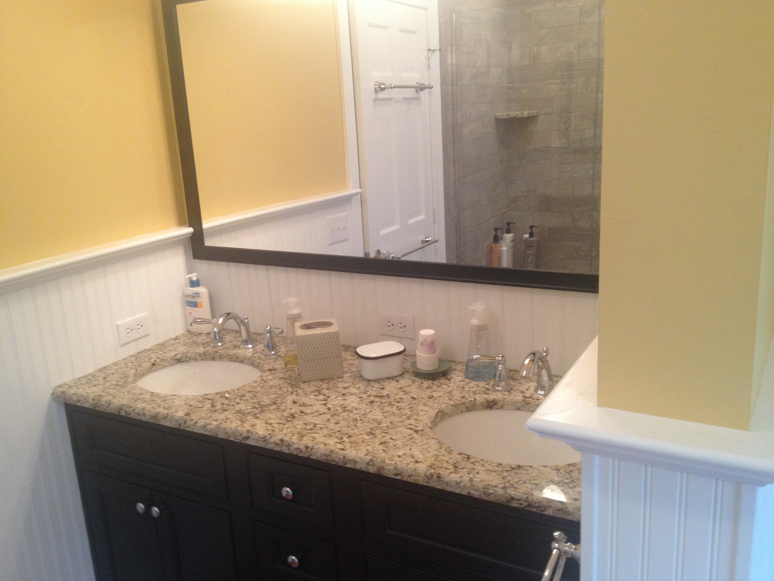 The vanity countertop matches the shower seat.