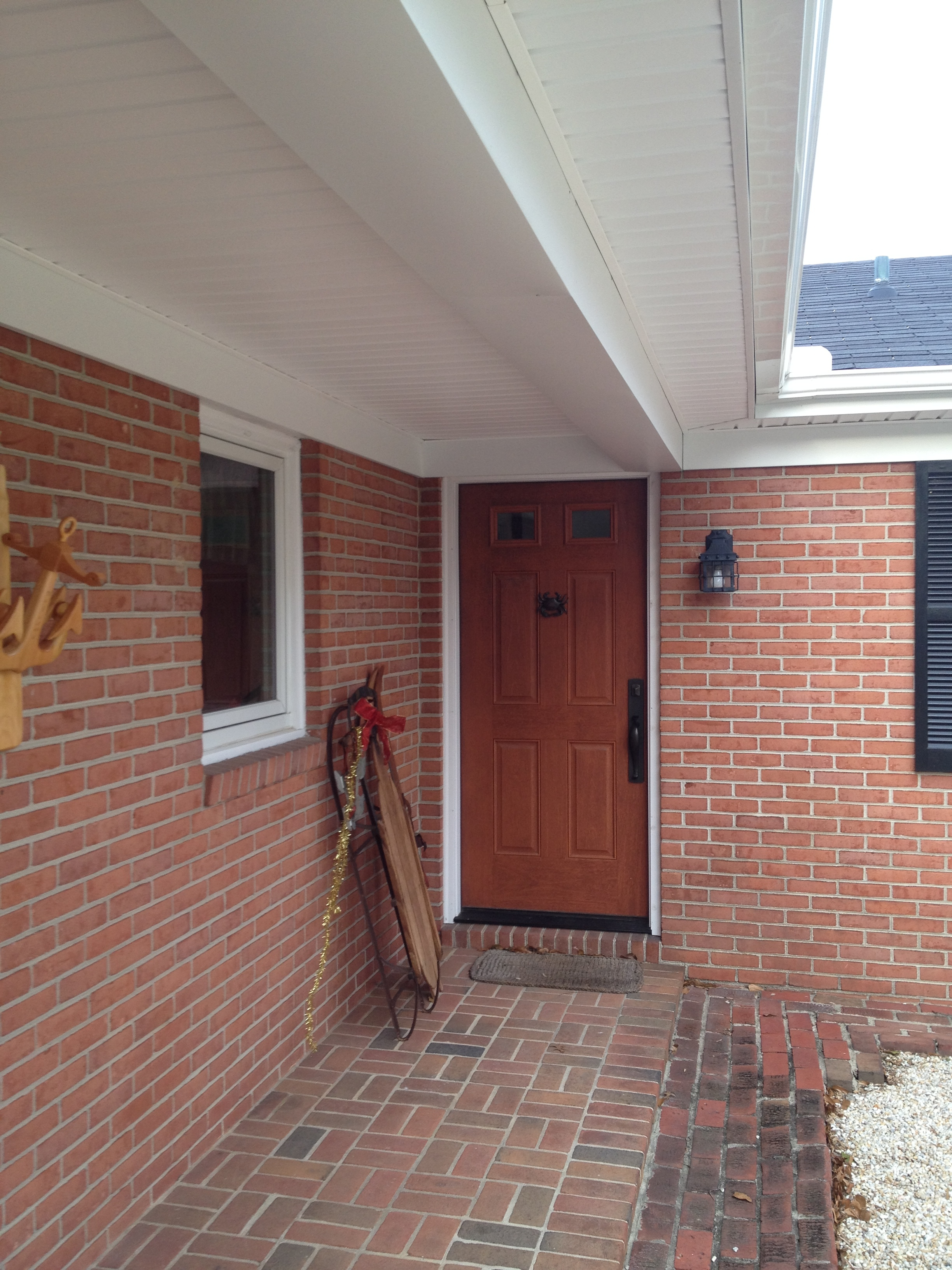 New fiberglass door. The door was stained before it was installed. The fascia and soffit are also new.