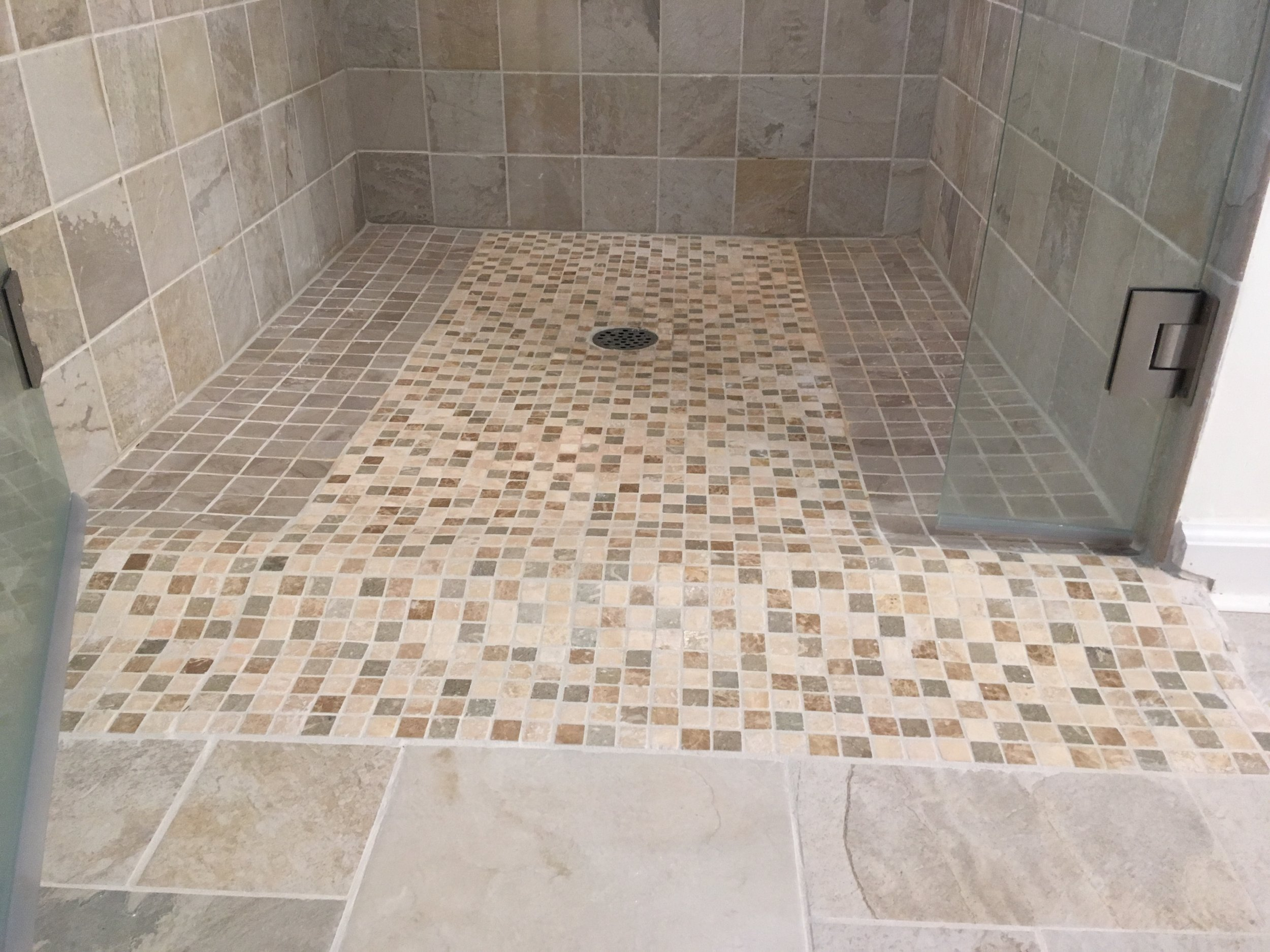 New tiled bathroom complete with Rain-X coating for glass doors, two niches, all new shower plumbing fixtures and tiles.