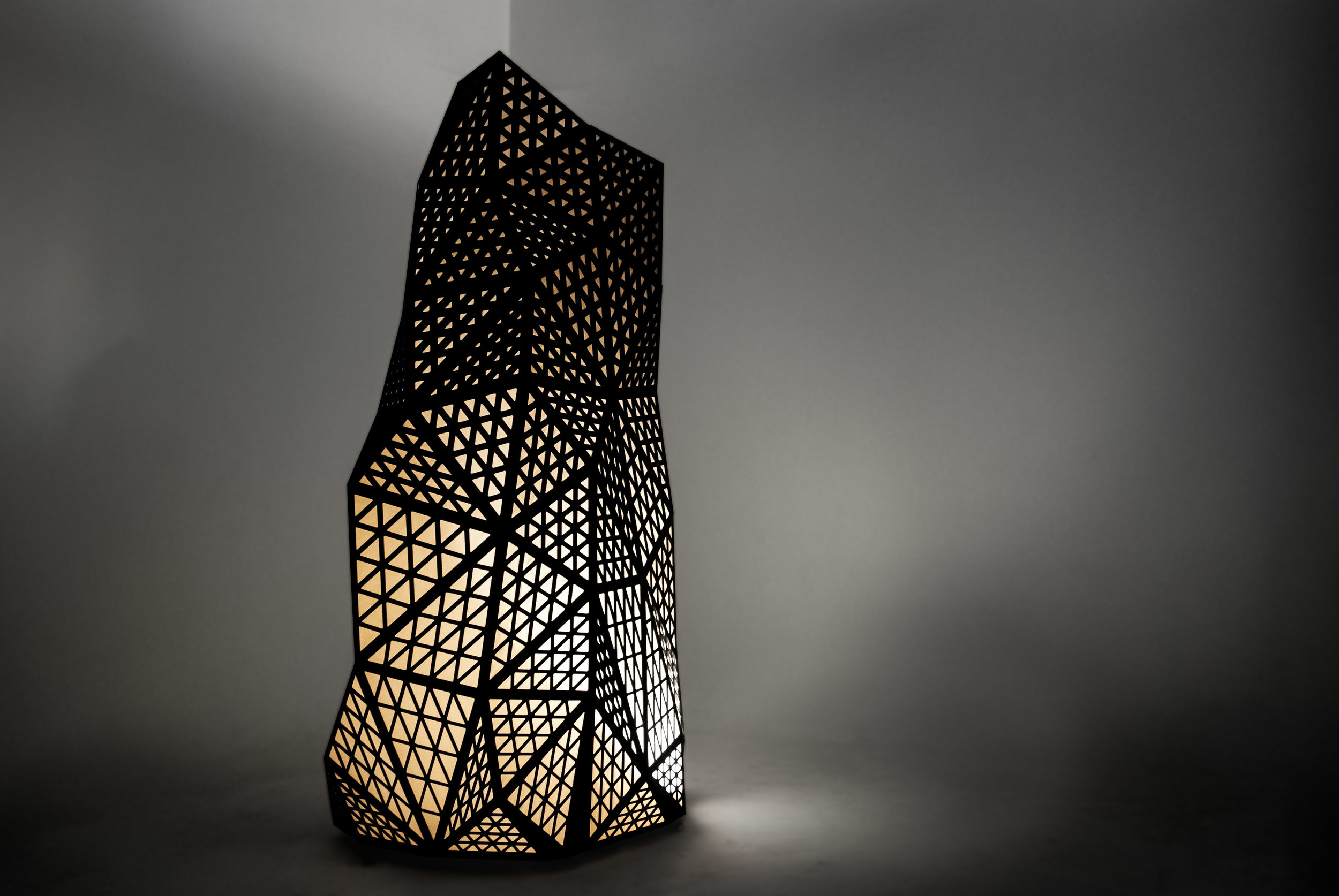 """Our proposal for an 8' tall geometric stalagmitic sculpture was chosen as one of four light-themed art installations featured at the first ever """"Light Up The Hills"""" Event in West Hills, BC."""