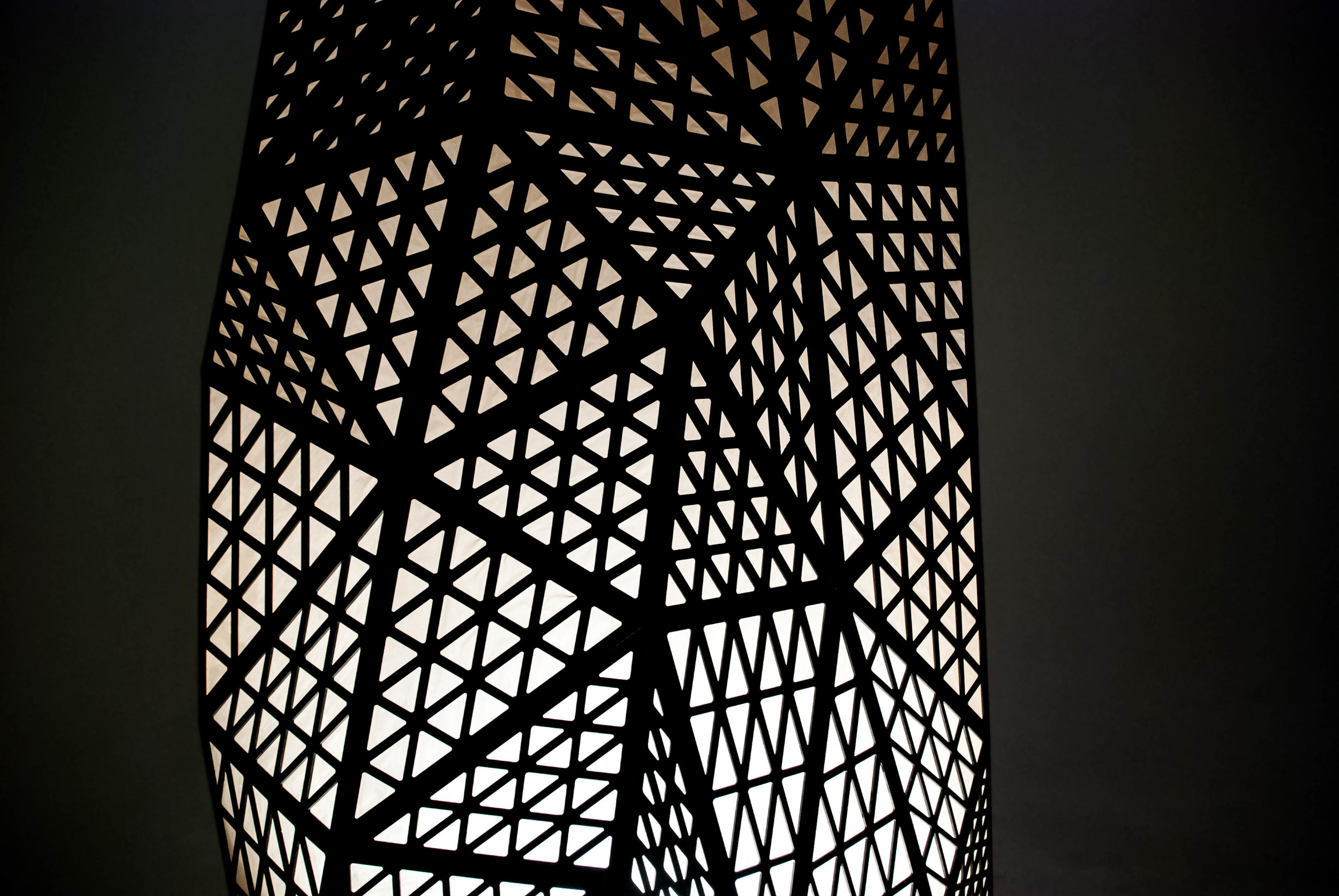 The complex structure was digitally designed using visual-based parametric scripting technology, then each piece was laser cut and the sculpture was assembled in-house.
