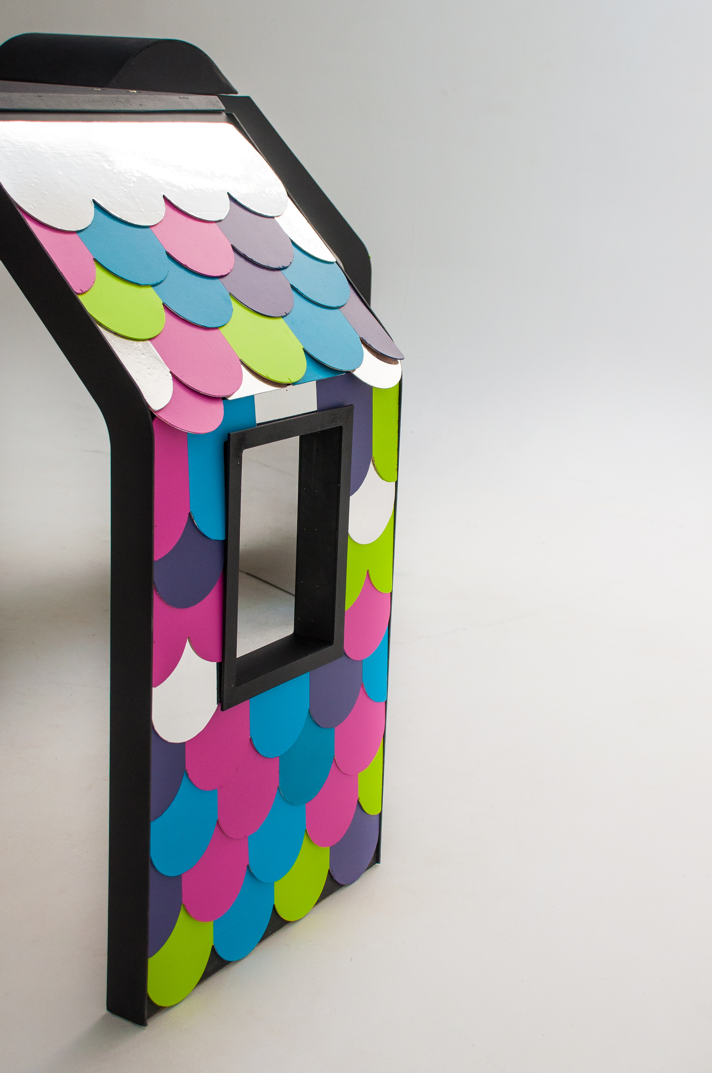 The resulting playhouse, clad in brand-coloured shingles and containing mirrored and magnetic interior surfaces, was designed and fabricated for maximum portability and super quick set-up & tear-down.