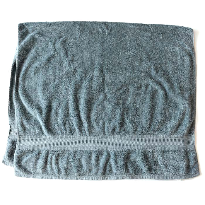 3. - Find a clean, flat surface that won't stain or damage from moisture. Lay a clean towel down on it.