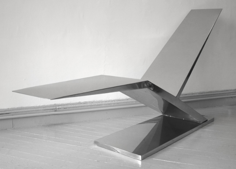 2007  Stainless steel and leather  39 x 17 x 78 in  (99 x 43 x 198cm)  The Wing Chaise Lounge follows the design structures of keels in sailboats and was inspired by folding butterfly knives. The Steel Wing Chaise Longue is a counter level technical challenge that can allow a person to sit on its very tip and the material will hold perfectly.  The single leather headrest includes inner magnets that allow it to be fix at any height without having to physically connect to the steel.