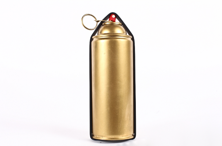2010    Oil spray can, industrial ru  bber band and custom safety pin    8-1/2 x 3 in (21,6 x 7,6cm)    This improvised  oil can/hand grenade was designed as a protesting tool in response to the 2010   British petroleum oil spill. The spraycap of the oil can is held pressured down by an industrial   rubber band; by pulling the safety ring the can immediately starts shooting oil. The concept follows the 80s tradition of animal rights activists throwing oil on people wearing fur as an act of protest.
