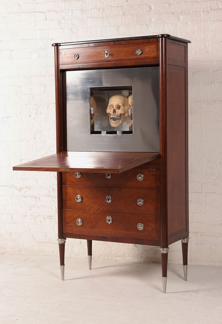 2007  Reclaimed French secretaire, stainless steel, resin and human skull  59-1/4 x 32 x 16 in  (150,4 x 81,3 x 40,6cm)  The Death Secretaire is inspired by the artist's grandfather, who had a similar desk where he kept his papers and documents until his last days. The Death Secretaire becomes a memento mori to his grandfather and a beautiful piece that offers us a door into other worlds.