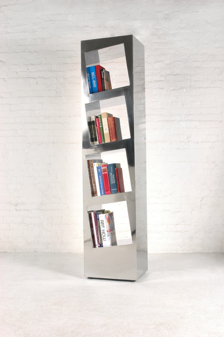 2007  Stainless steel  75-1/4 x 17-1/4 x13-3/4 in  (190,5 x 43,2 x 34,4 cm )  Leaning Stainless Steel Shelf seeks to create functional volumes within a sculptural volume. The slanted sides allow the books to always stay in order and the stainless steel reflects the colors of the books placed in its interior almost like the surface of a mirror.