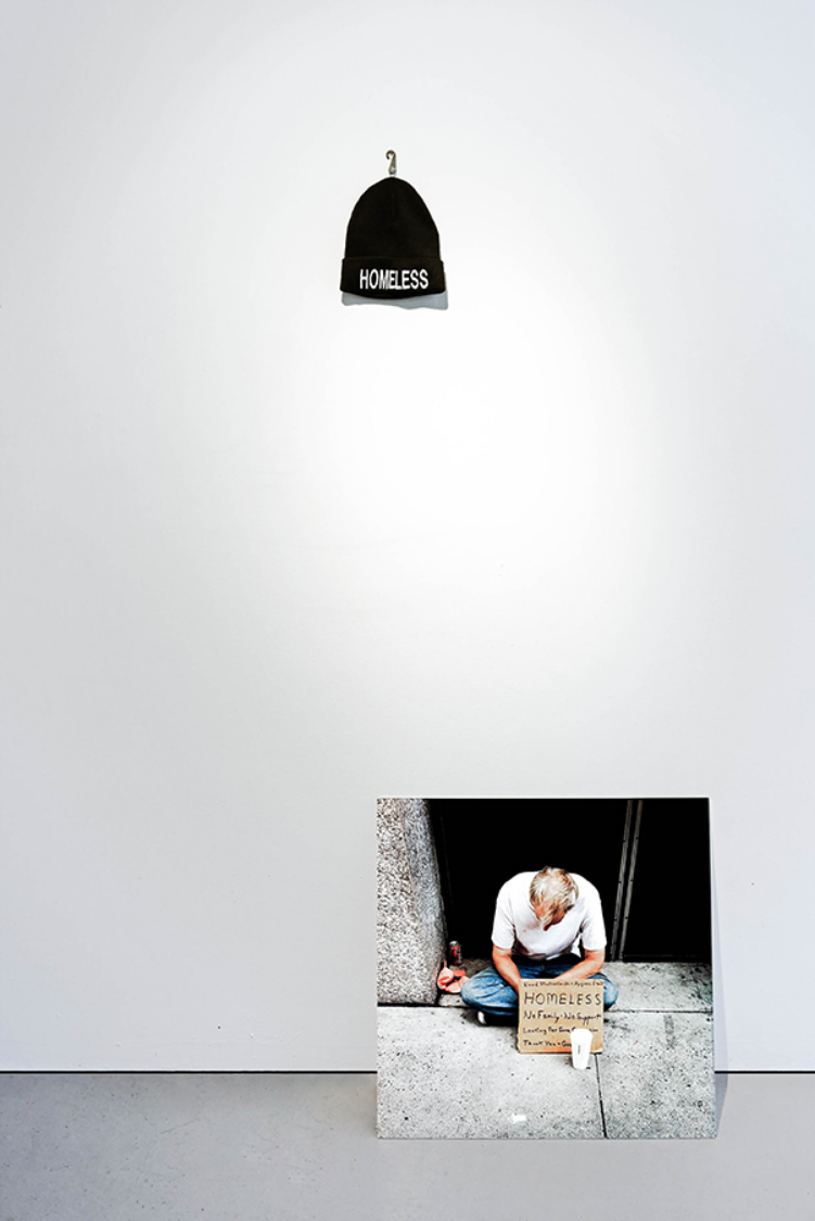 2012     Embroidered wool hat and photograph    Dimensions variable     New York has over 50,000 homeless people in municipal shelters. 22,000 are children.     Recent statistics show that homelessness has already increased 13 percent more in 2013 than in previous years.