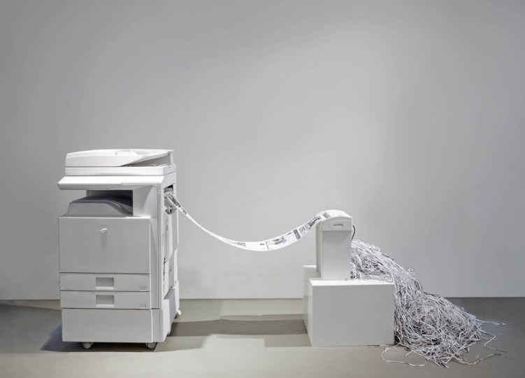 2013    Sebastian ErraZuriz and Carlton DeWoody   Office printer, shredder, news clips and video projection Dimensions variable     In the United States, authorities do not maintain a record of civilians permitted to acquire, possess, carry, sell or transfer a firearm or ammunition. Privately owned guns in the U.S. are estimated to be approximately 310,000,000. With an average of approximately 30,000 deaths a year caused by firearms, one would expect strong government control.      The printer reproduces a selection of past newspaper articles announcing different gun massacres that have happened in the United States. The non-stop roll of terrifying articles manages to exist for barely enough time to be read by the viewer, before they are destroyed and forgotten by the shredder.      Each shredded news clip of gun massacres over the past 10 years is framed and available for sale. This artwork will continue to evolve and will only be completed by the artist when a comprehensive gun law is passed in the United States.