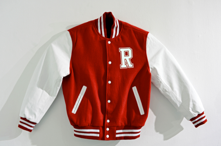 2013   Modified Varsity Jacket   43 x 1 x 28-1⁄2 in   (109,2 x 2,5 x 72,4cm)    According to statistics one in five women on a given college campus will be raped; 85 percent of those women will know their attackers; and 90 percent of those rapes will go unreported. The male student athletes accused of rape often receive support from the schools while the girls tend to suffer public shame until silenced.    According to legal reports, athletes represent a disproportionately high percentage of sexual attackers. School administrations, coaches and even the community tend to defend them because they represent the values of the school and because of the power and ultimately, money involved. Considering the NCAA estimates college sports generate about $6 billion in revenue a year, one could infer that money often stands in the way of justice.    The jacket and its potential sale will help fund the legal defense of a future victim of college rape and provide a broader public awareness and discussion of the issue.