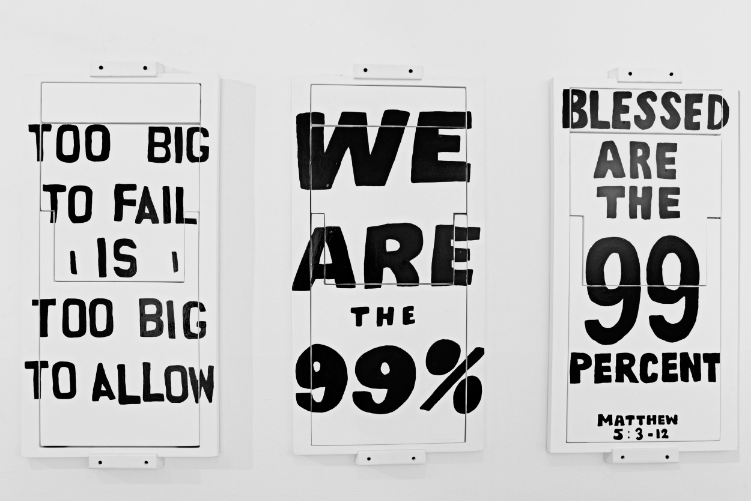 2012  Lacquer and acrylic on plywood  341/2 x 18 x 1 in. (90.2 x 45.7 x 2.5 cm)  The original Occupy Chairs were first designed by Sebastian to work as a complaint sign during the day that would fold out as a chair for the protesters to use next to their tents at night. The second stage of the project was to create an attractive pop version of the Occupy Chairs that could work as a Trojan horse for the 1%. Now camouflaged as a glamorous art-objects the Occupy Chairs where presented next to modern art masterpieces at the 2012 NY Armory Art Show in an attempt to get the collectors of the 1% to purchase the signs and take them home; where those signs would later hopefully start questioning their owners from within.  The chairs walk the boundaries between art and design as a functional piece that can also fold flat and be hung on the walls to work as a painting or a sign of political and social injustice. It was the artist's intention to avoid the easy demagogy of a politically correct art project that would simply attack the rich.  He was interested in illustrating how both the 99% and the 1% could be more similar than they believed if their economic circumstances where to change. This is why instead of simply pointing a finger at the collectors as the villains of the 1%, he decided the project also needed to question his own range of personal intentions and aspirations as an artist of the 99%.  The press release written by the artist purposely underlined that ErraZuriz would not disclose whether he would donate 1% or 99% of the profits of the sales of the Occupy Chairs.  He expressed that he didn't know if once he received the money he would stand by his ideals and donate the money to help the cause of the 99%, or keep the money for himself and give into the greed and fame of which the 1% are accused. Embracing both a selfish and selfless potential of the project in an open way ignited a much stronger and more interesting discussion on multiple news outlets, capturing