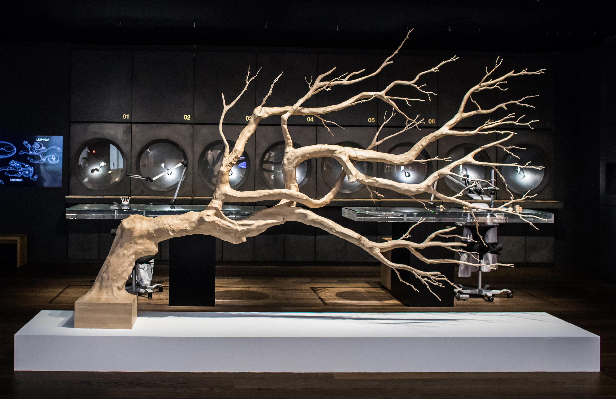 """Art Basel Collector's Lounge for Audemars Piguet (Hong Kong, Basel, Miami), 2017  For the second consecutive year, Sebastian Errazuriz was invited to design Audemars Piguet's vip lounge at Art Basel, Hong Kong and Miami. The new installation will be launched at Art Basel Hong Kong on March, 23 rd 2017 and on view during the entire fair.  The new design is inspired by the vast forests in the Jura Mountains, reminding us of the Manufacture's deep sense of history and endless growth. """"During my visit to le Brassus in 2015, I was captivated by the trees that are native to the region of the Vallée de Joux. It seemed as though they drew a natural symbolic connection to Audemars Piguet.""""  The spruce trees that grow near the Manufacture usually look tall and straight, from the trunk all the way to the end of the branches. For the lounge, Sebastian Errazuriz created a tree that had meaning and was not like the others, a tree that was unique in its shape and identity."""